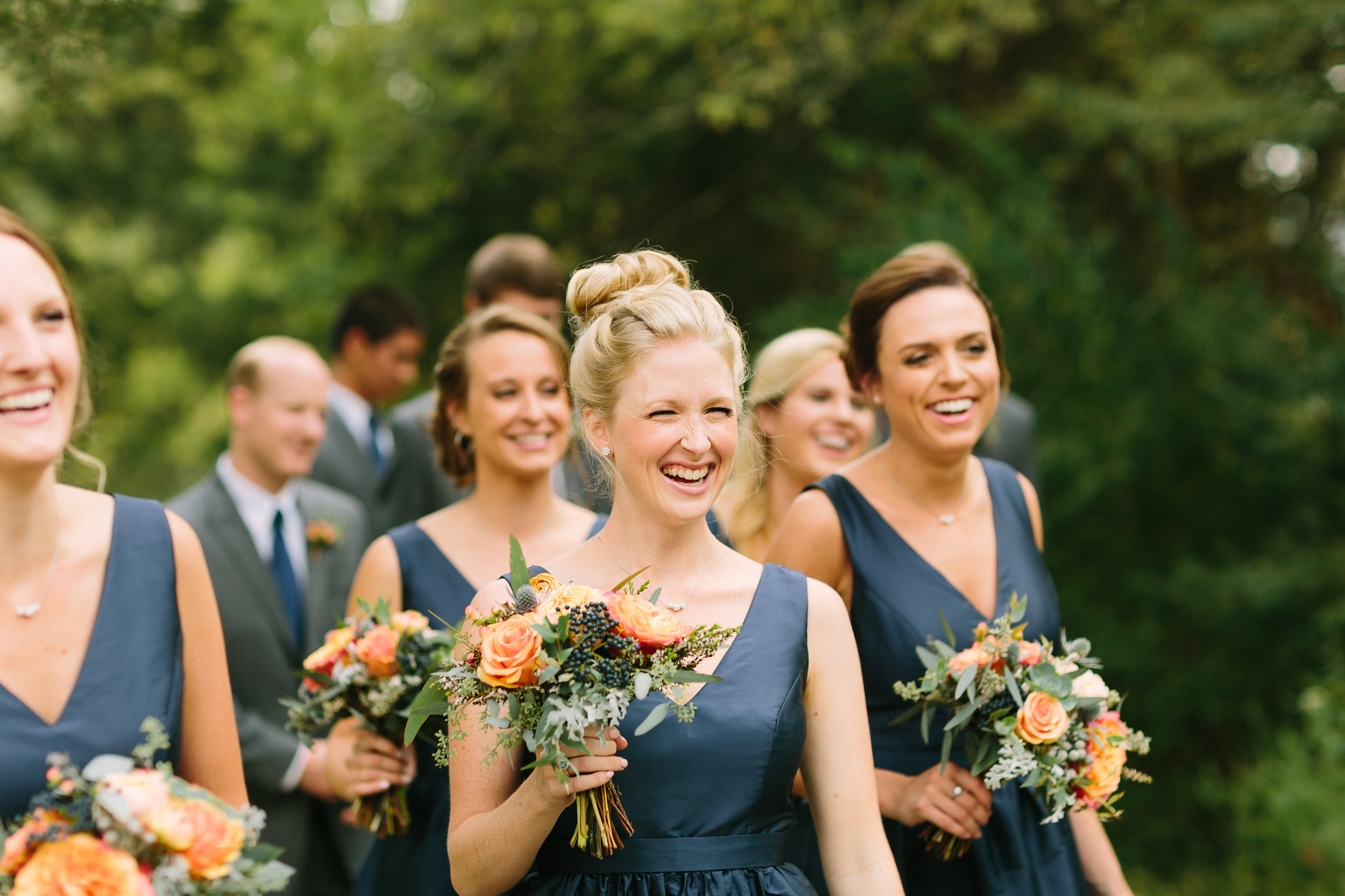 Bridesmaids in navy with coral flowers // Nashville Wedding Florist