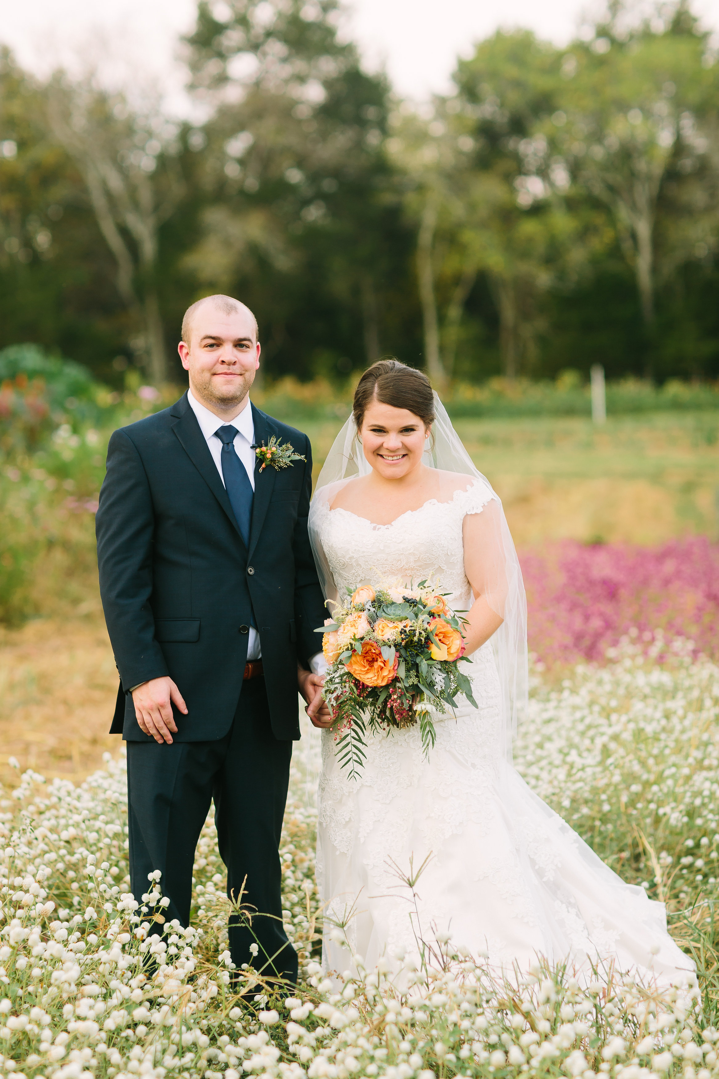 Bride and Groom portrait in flower garden // Nashville Floral Design