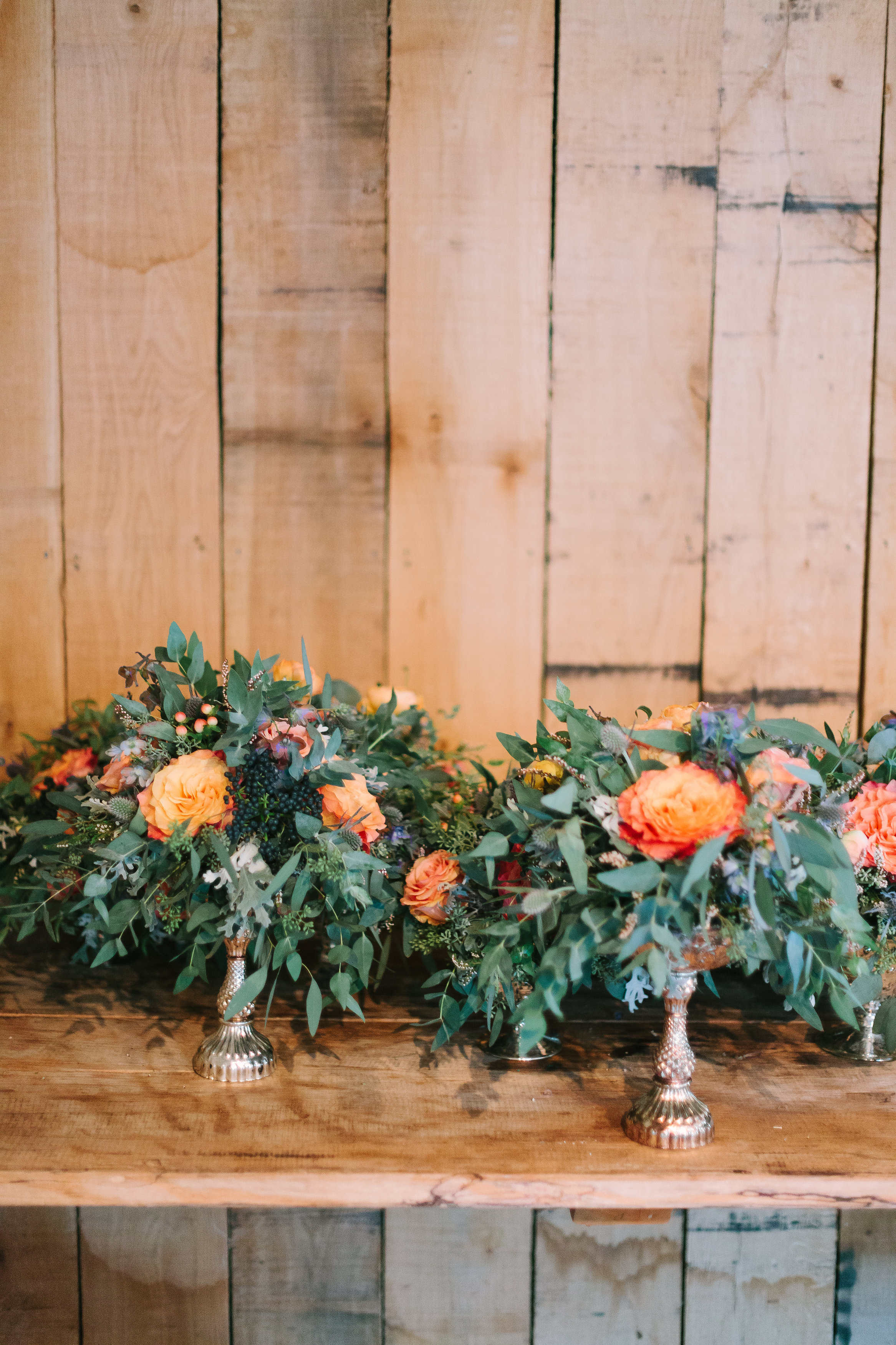 Coral and navy floral arrangements