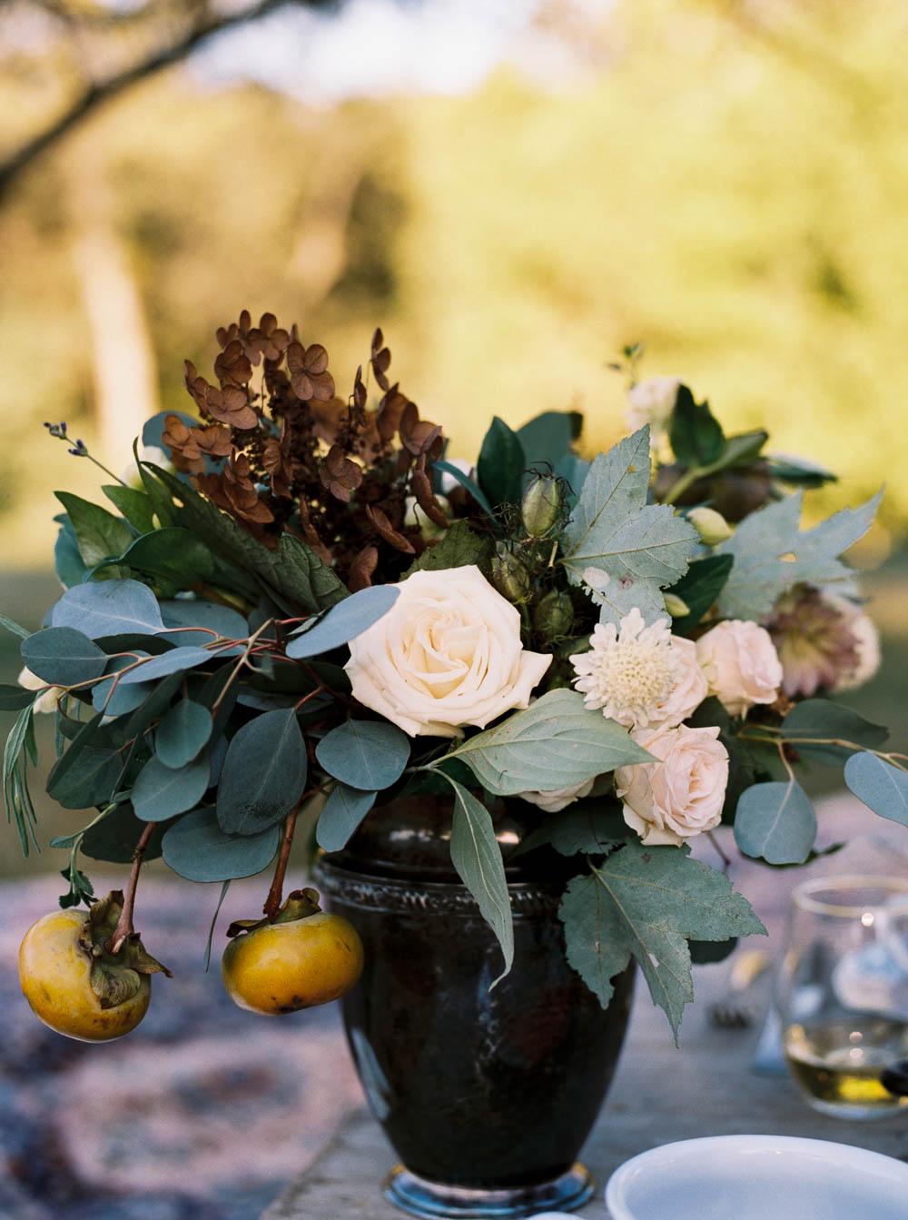 Lush Thanksgiving centerpiece with persimmons // Nashville Inspiration Shoot