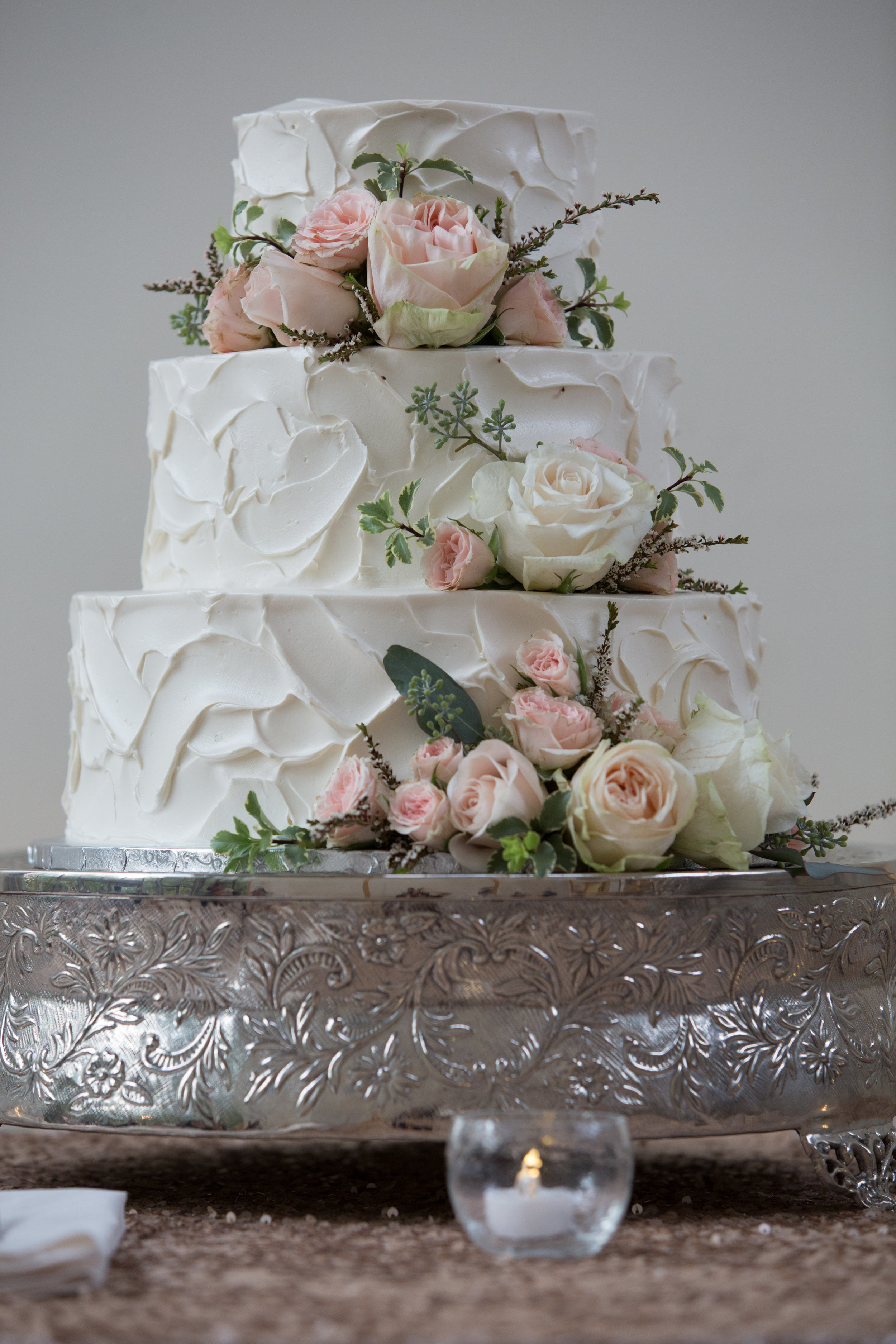 Wedding cake with garden roses and greenery