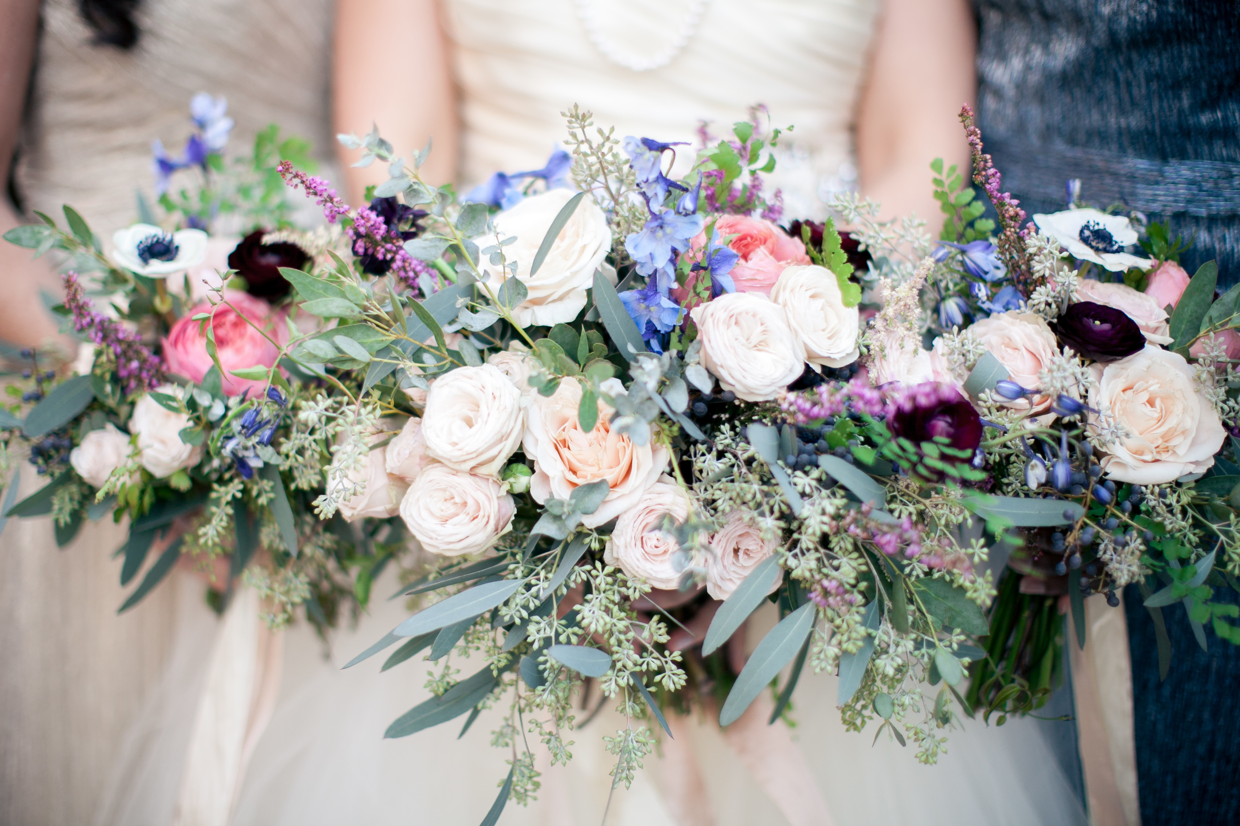Lush Bouquets with pops of burgundy, rose pink, and blue