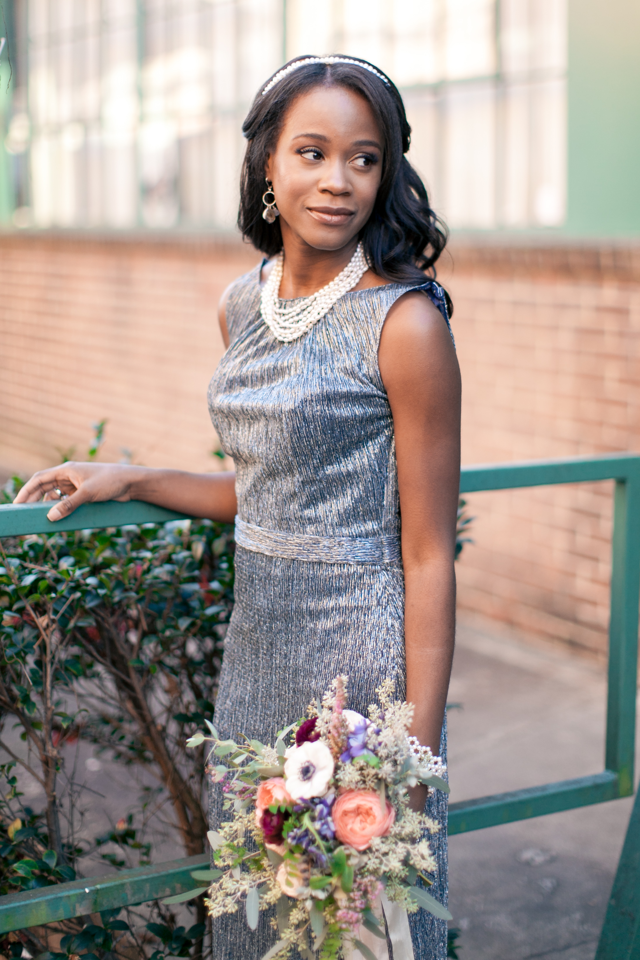 Shimmering bridesmaid dress with lush, natural flowers // Southeast Wedding Floral Designer