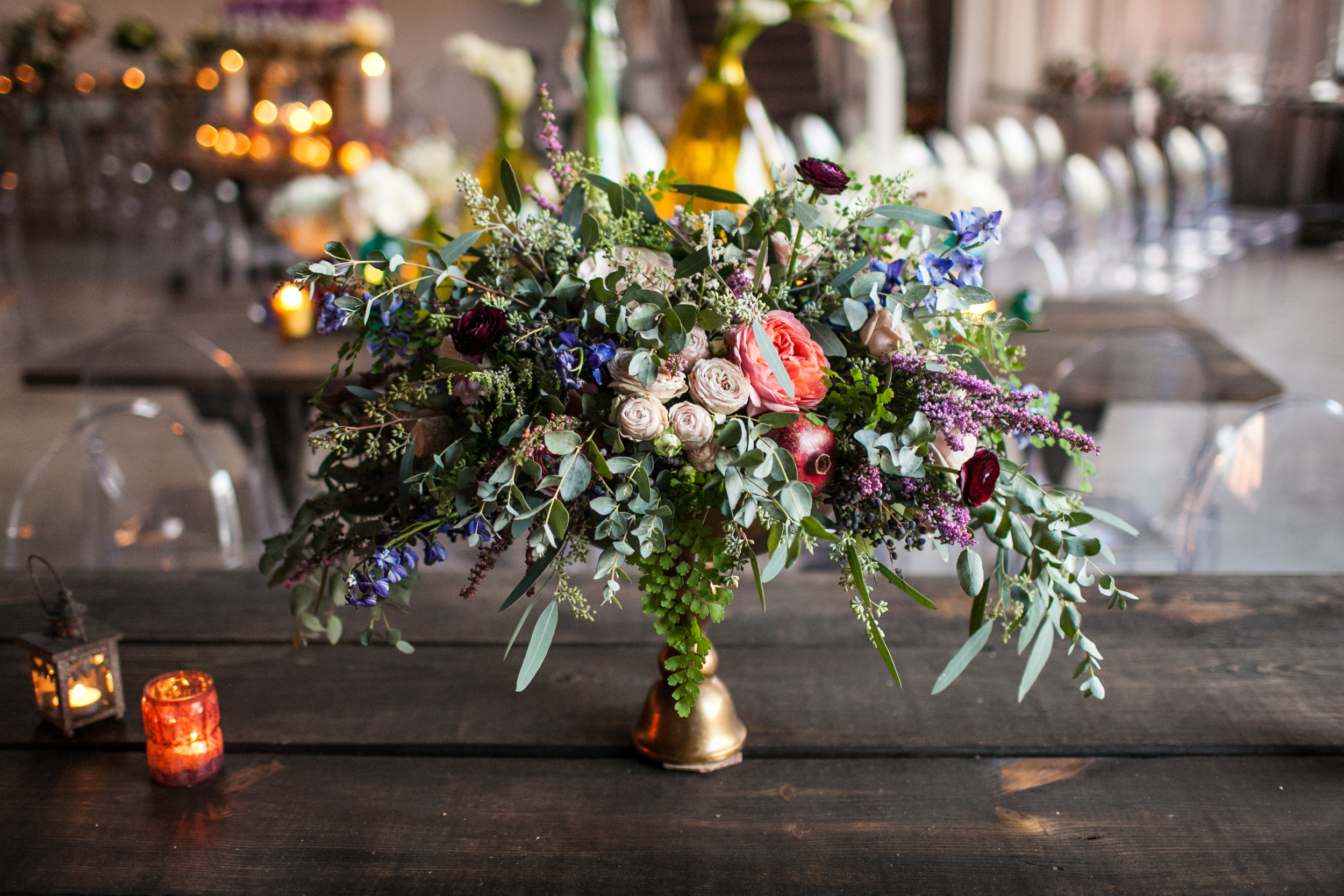 Organic, natural centerpiece with pomegranates and other pops of pink and blue // Nashville and Southeast Floral Design