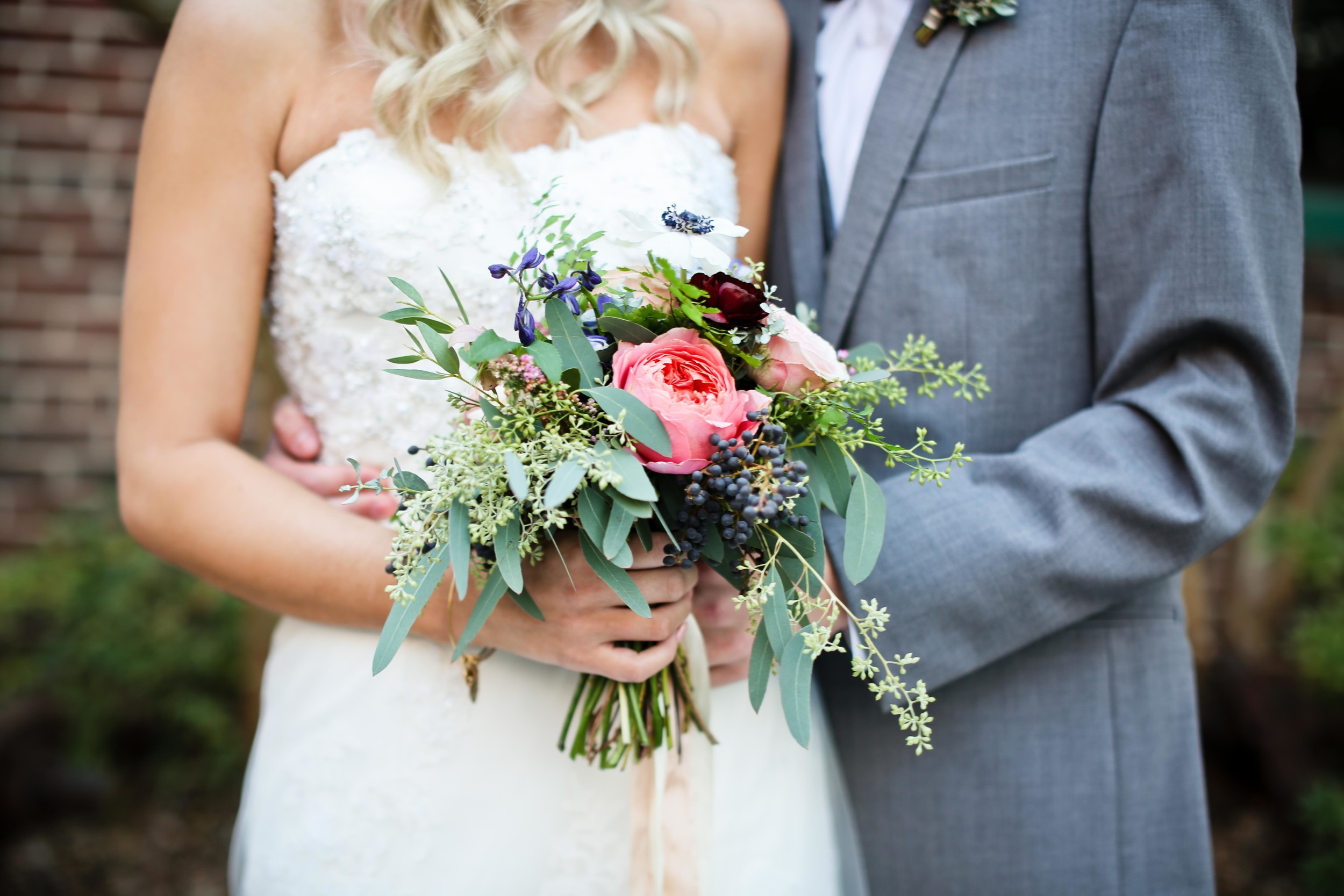 Lush bridal bouquet with rosy pink garden roses, anemones, and navy berries // Nashville and the Southeast Florist