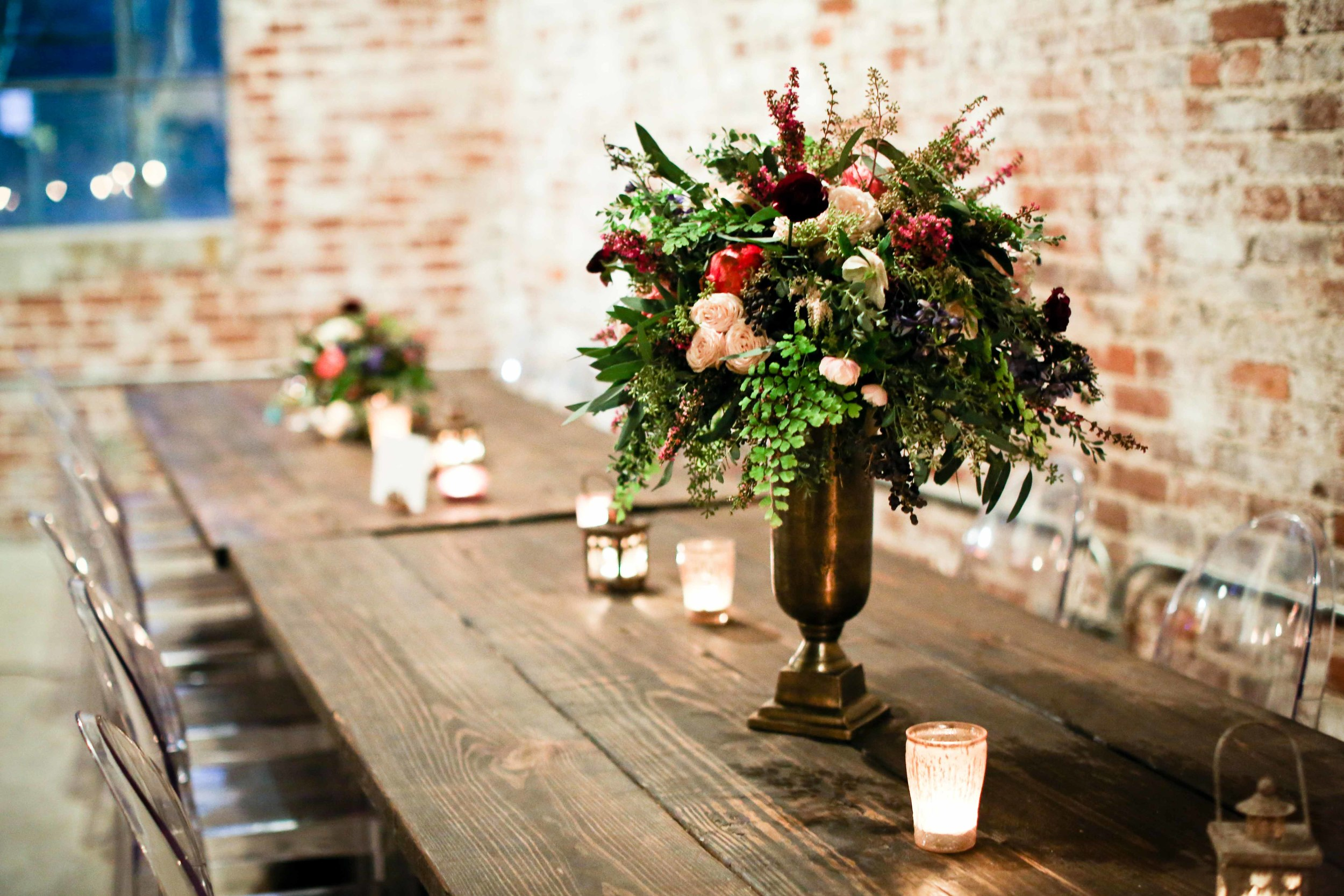 Loose greenery centerpiece with pops of color // Nashville to Atlanta Florist