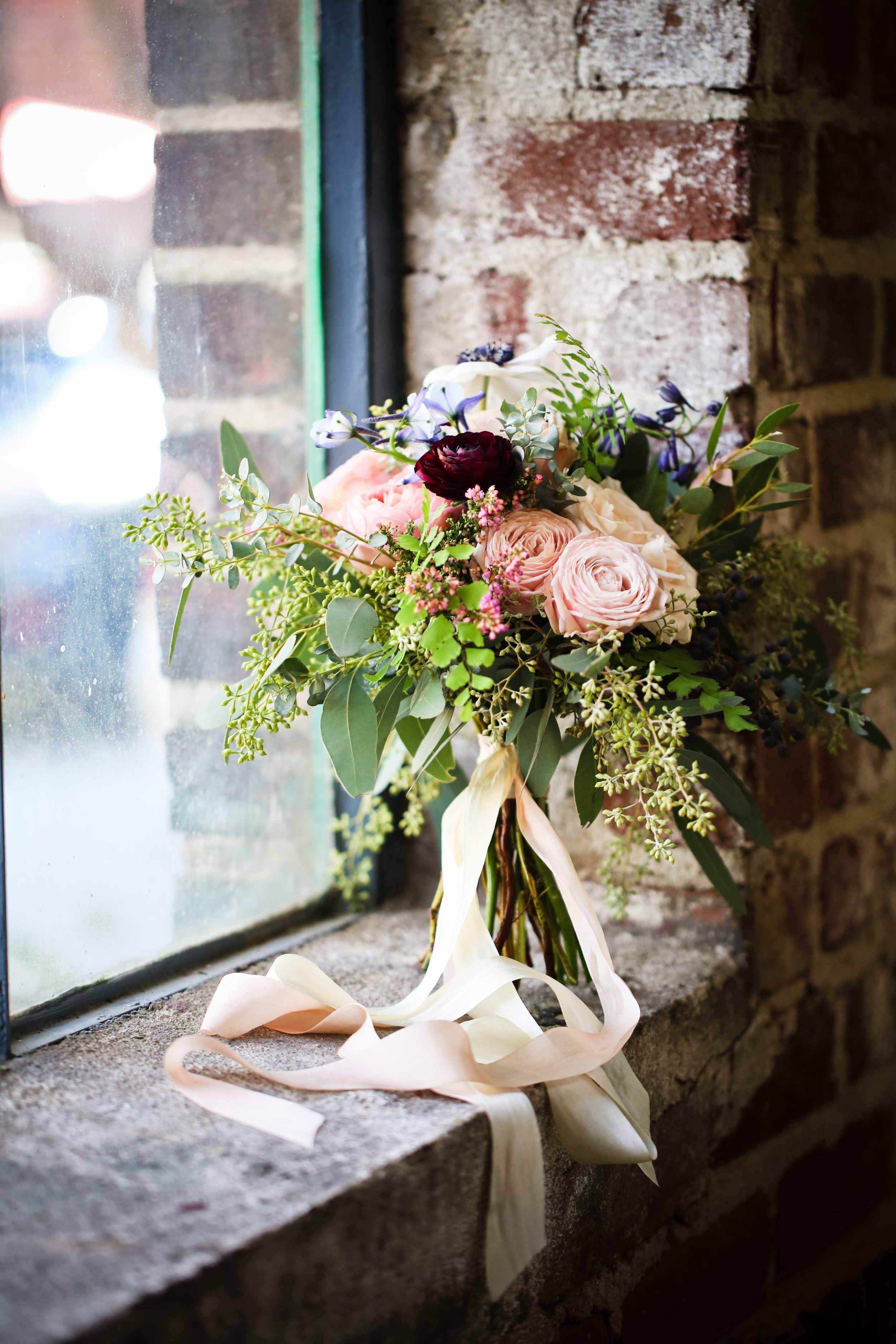 Loose, organic bouquet with touches of deep plum and light blue //