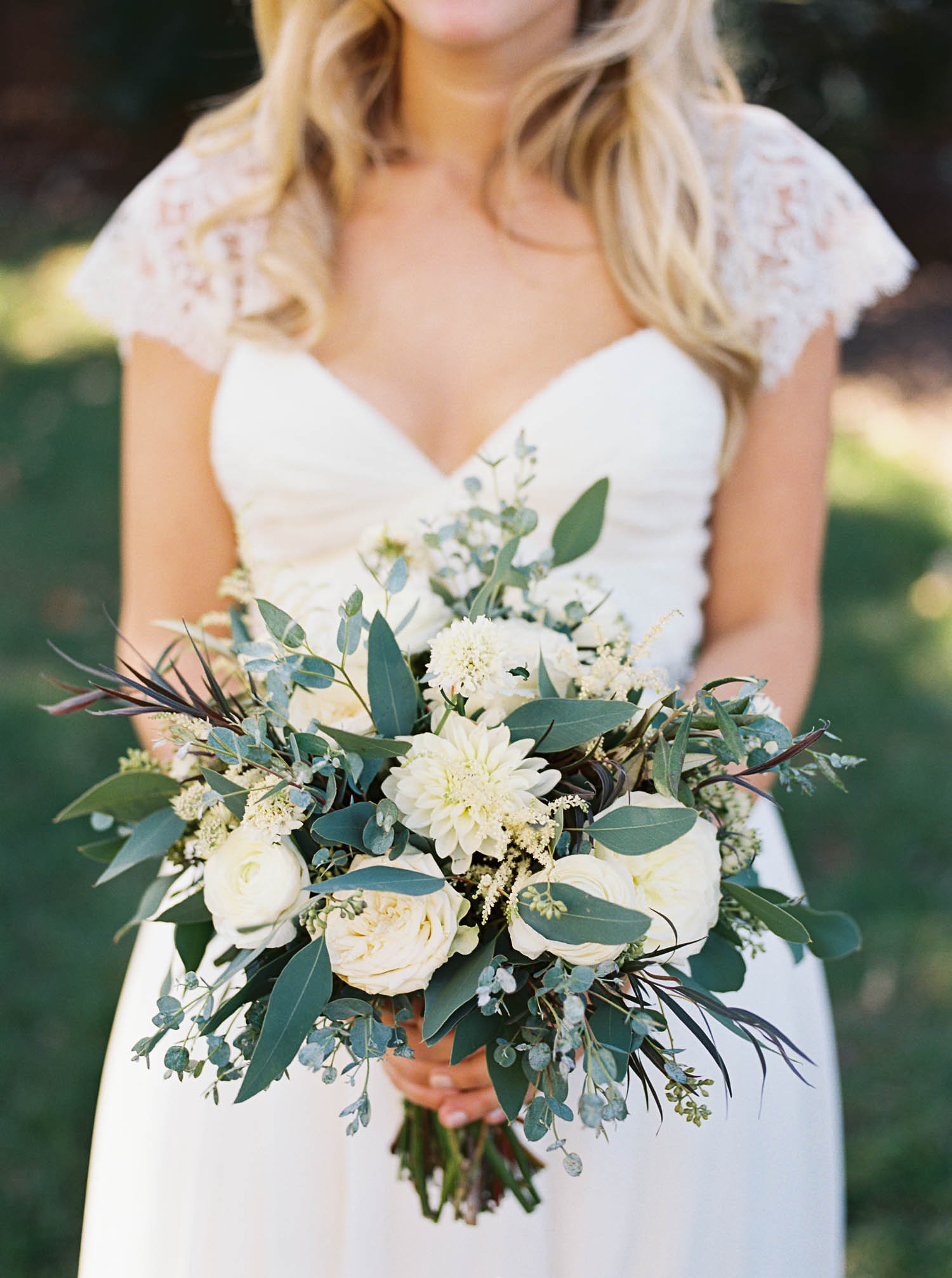 Loose, organic bridal bouquet with all white flowers // Nashville Florist