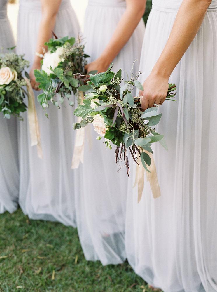 Soft blue bridesmaid dresses with blush, neutral, and greenery bouquets // Nashville Botanic Garden Wedding Florist