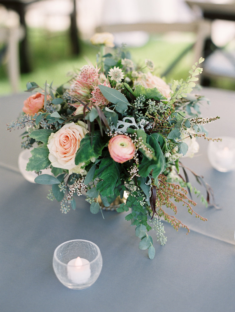 Lush centerpiece with peach and blush ranunculus // Nashville Upscale Wedding Floral Design