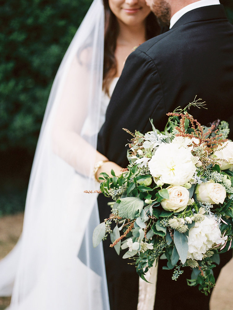Intimate moment between the bride and groom / Botanic Garden Wedding Floral Design
