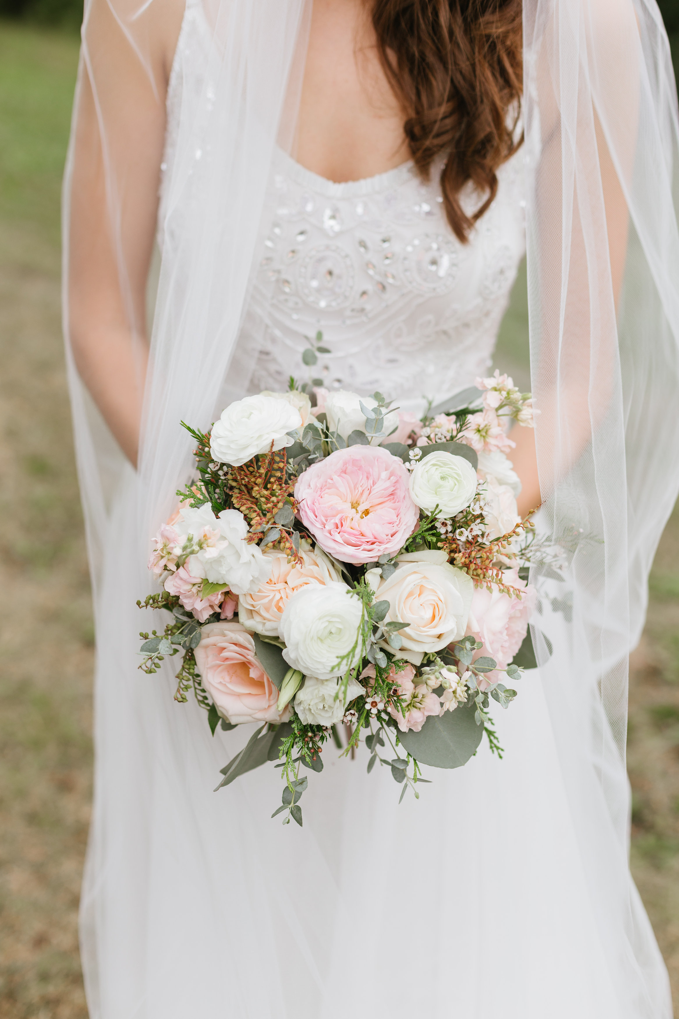 Bridal bouquet with david austin garden roses, pieris, and wildflowers