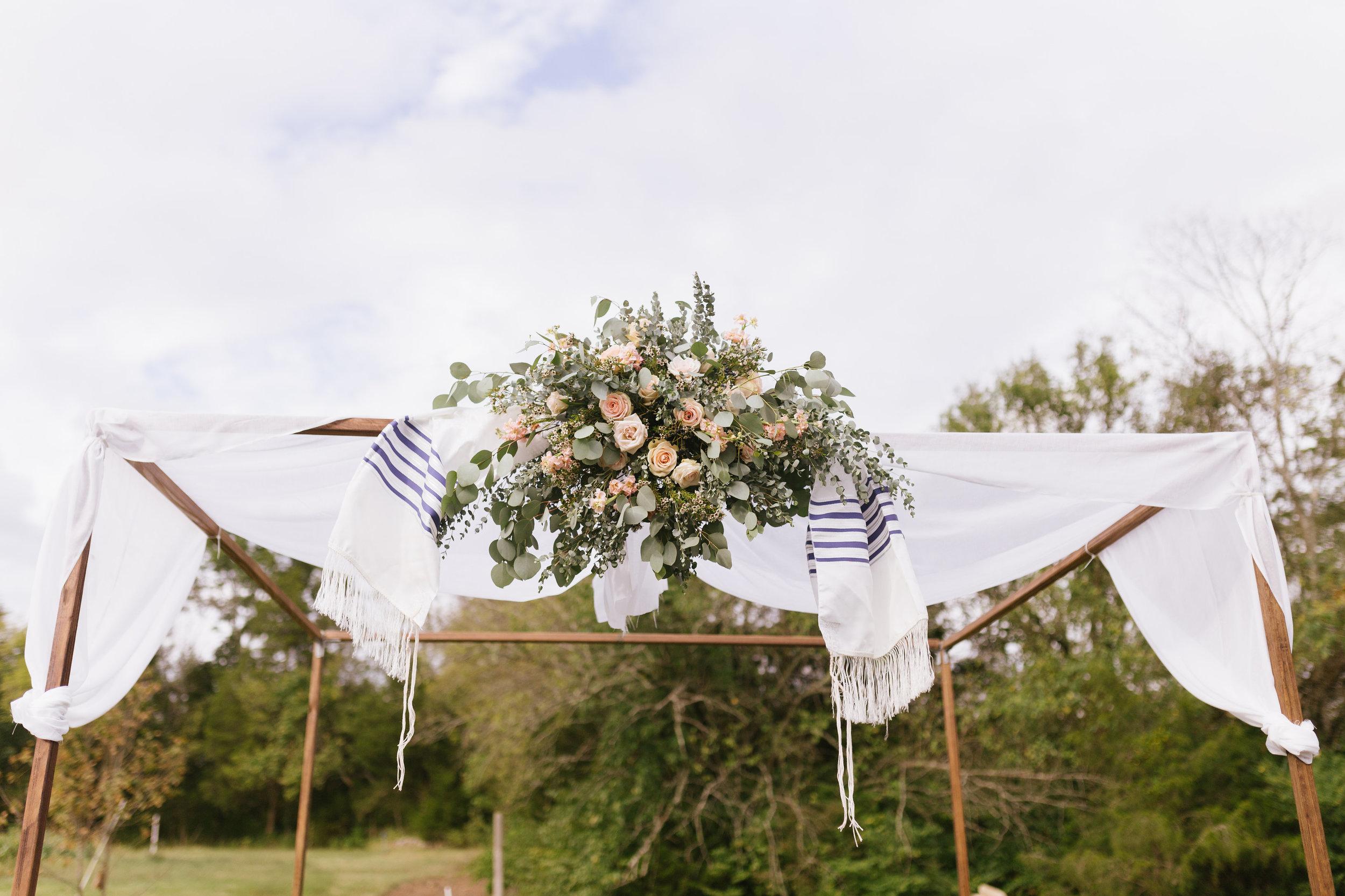 Traditional chuppah with loose floral spray // Nashville Wedding Florist