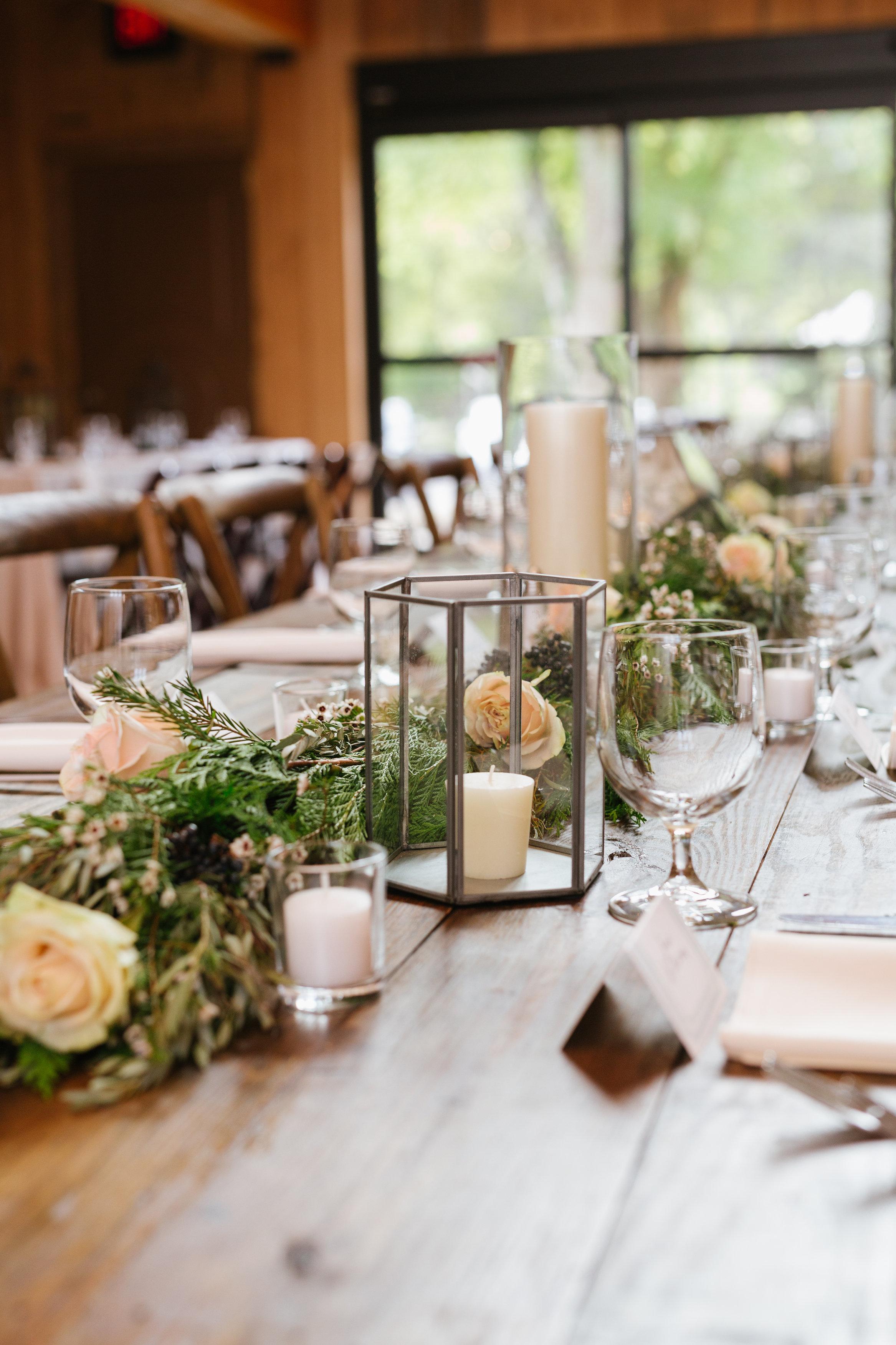 Lush garland runner on farm tables // Nashville Floral Design