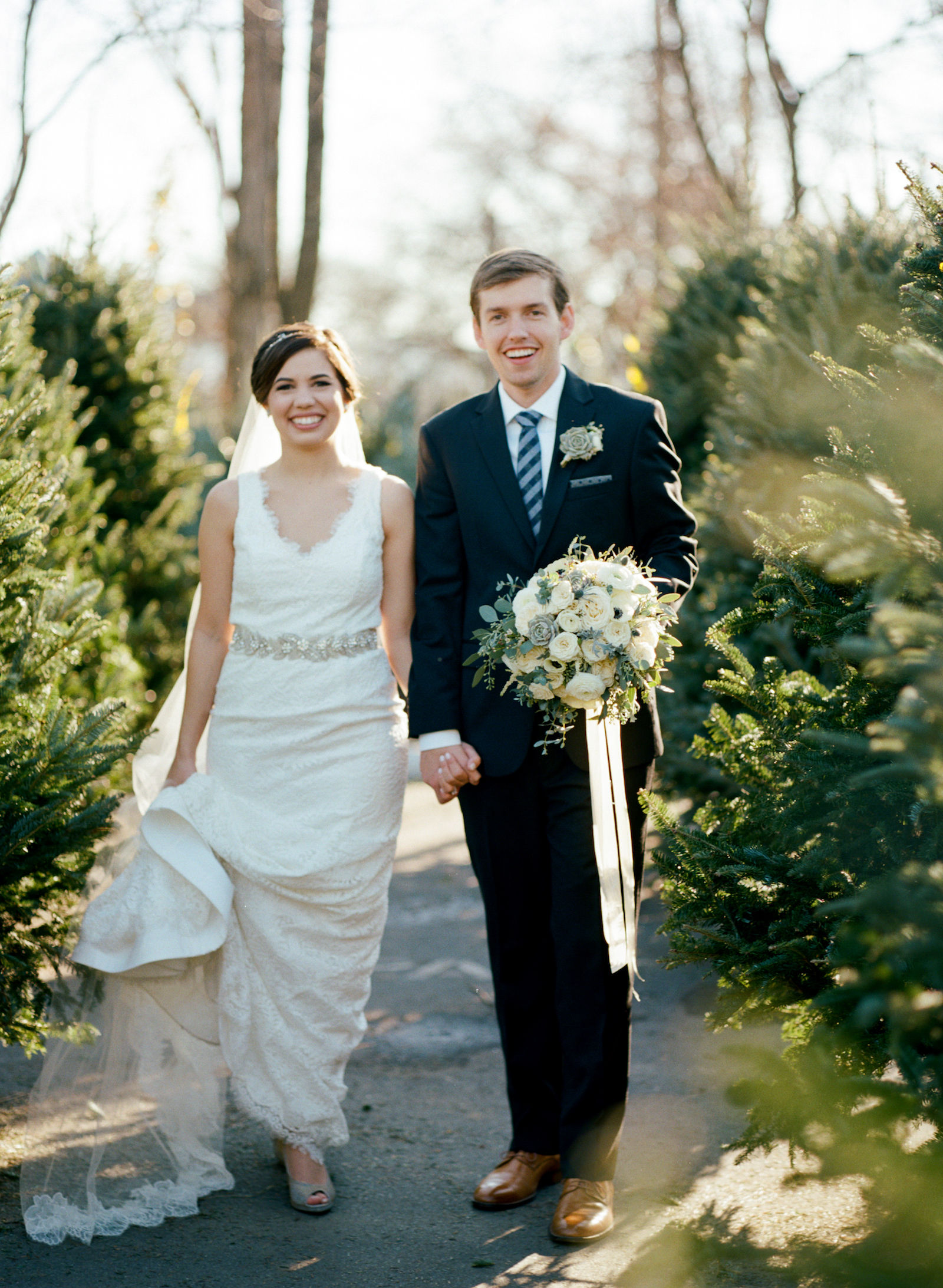 Bride and Groom in Christmas Tree Lot // Southern Wedding Floral Design