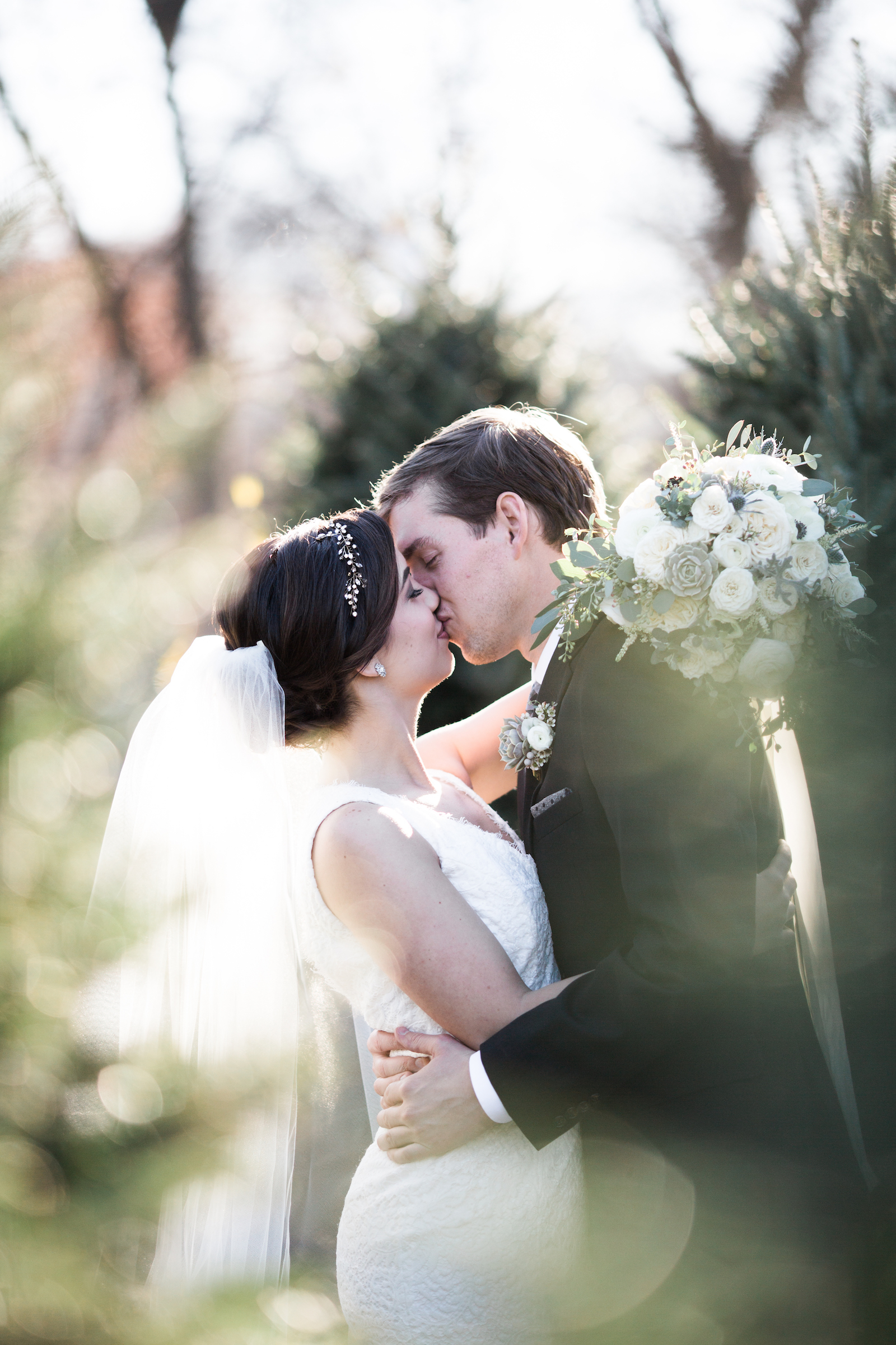 Newlywed portraits at a Christmas tree lot // Nashville Floral Design
