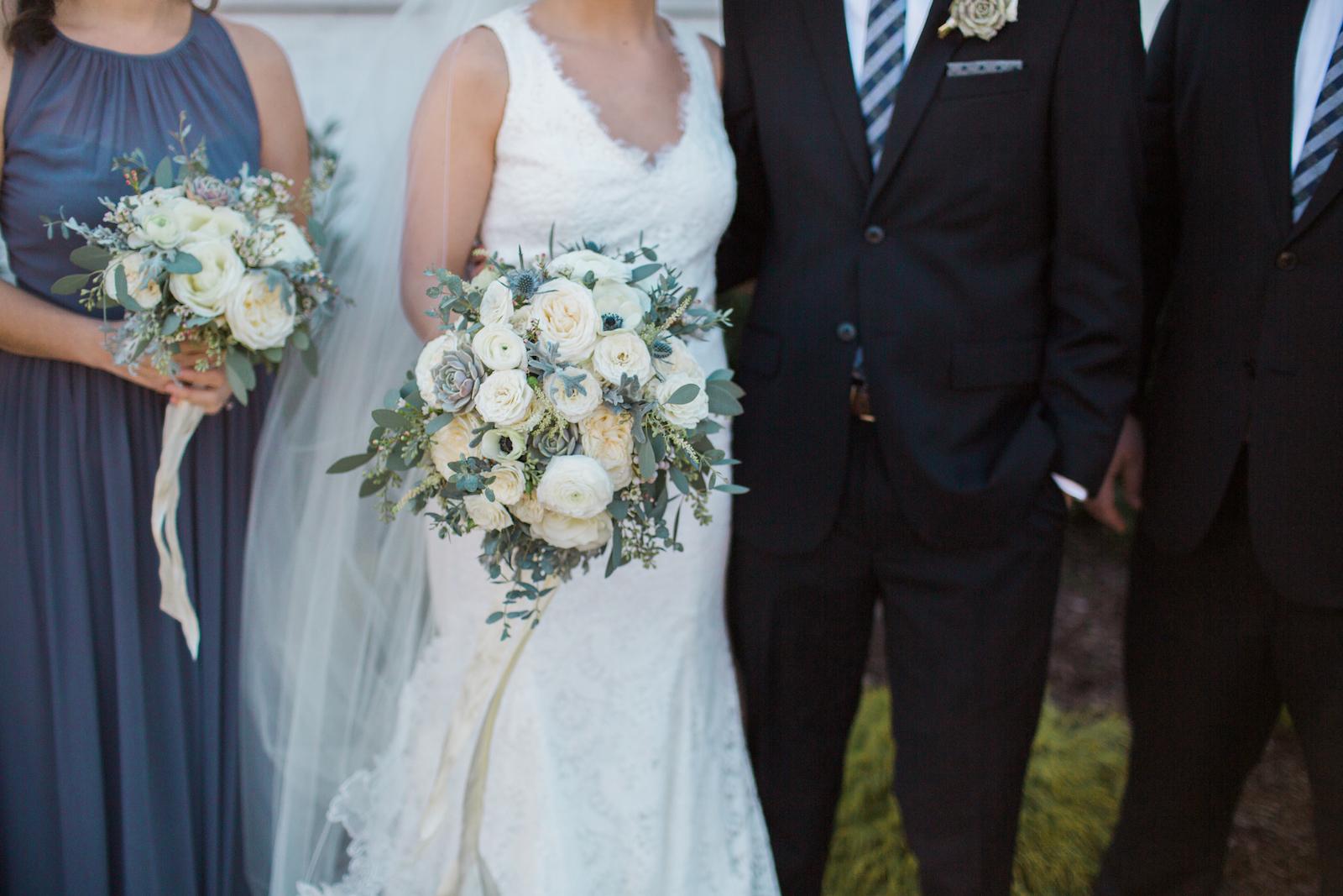 Lush winter wedding bouquet with white florals and anemones // Nashville Florist