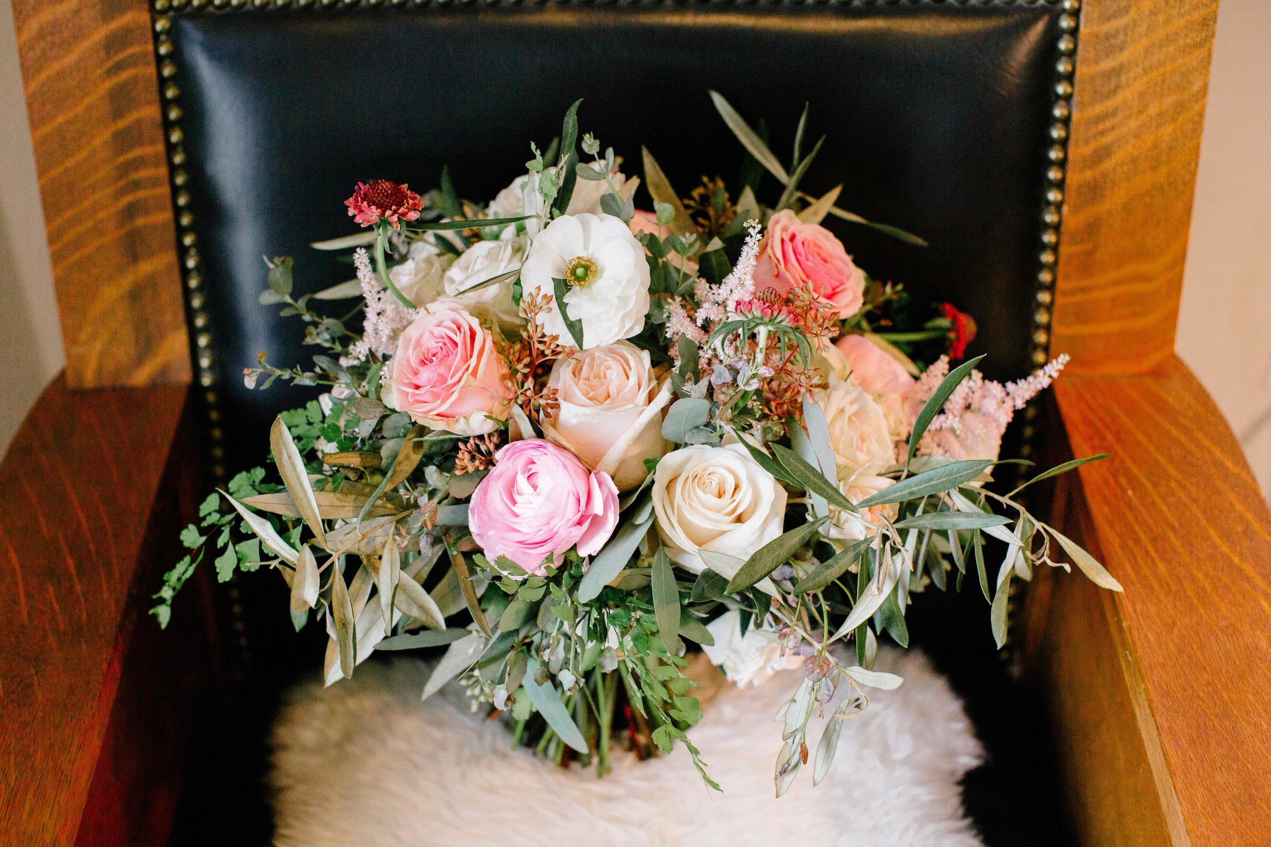 Loose blush and neutral bridal bouquet with hints of raspberry // Nashville Floral Design