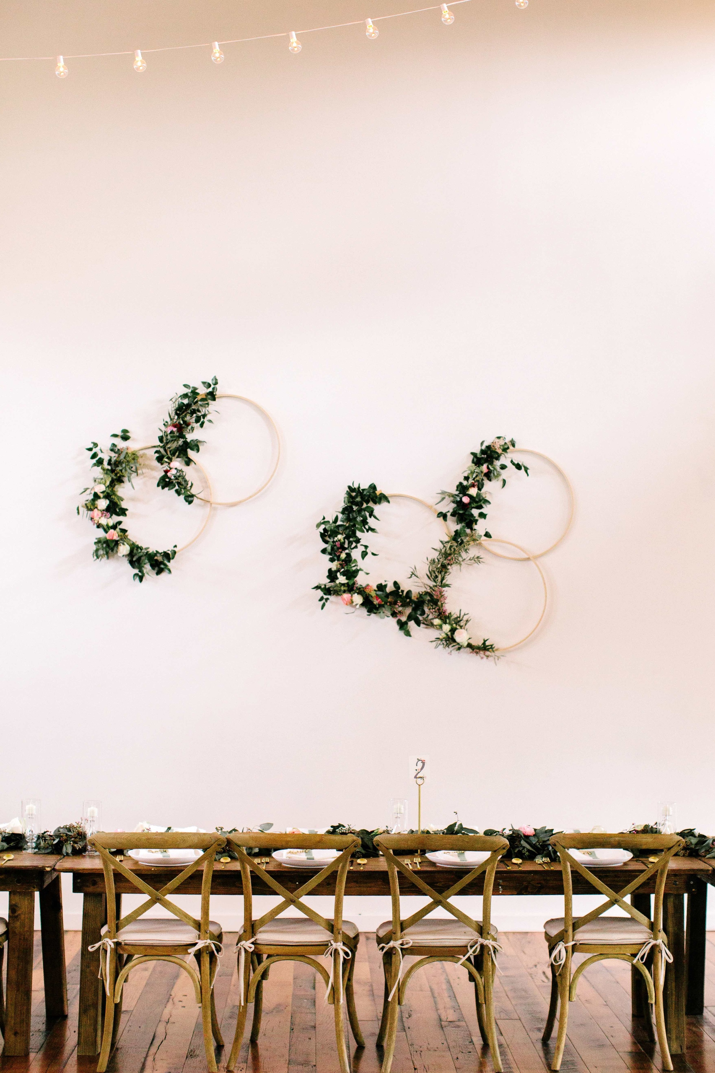 Wooden hoops with floral accents // Floral Installation on white wall for Nashville Wedding at the Cordelle