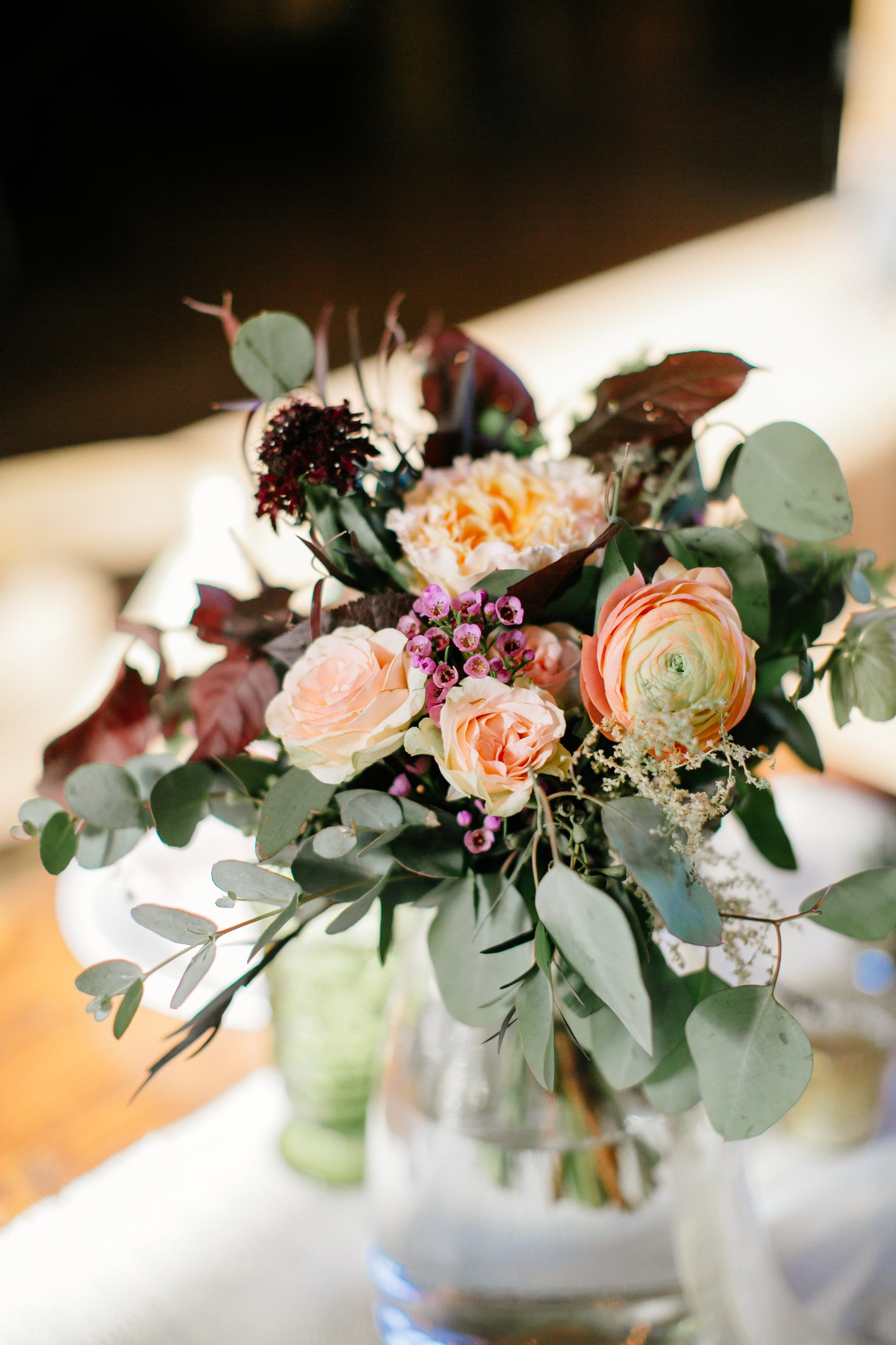 Peach Ranunculus, maroon foliage // Nashville Wedding Florist