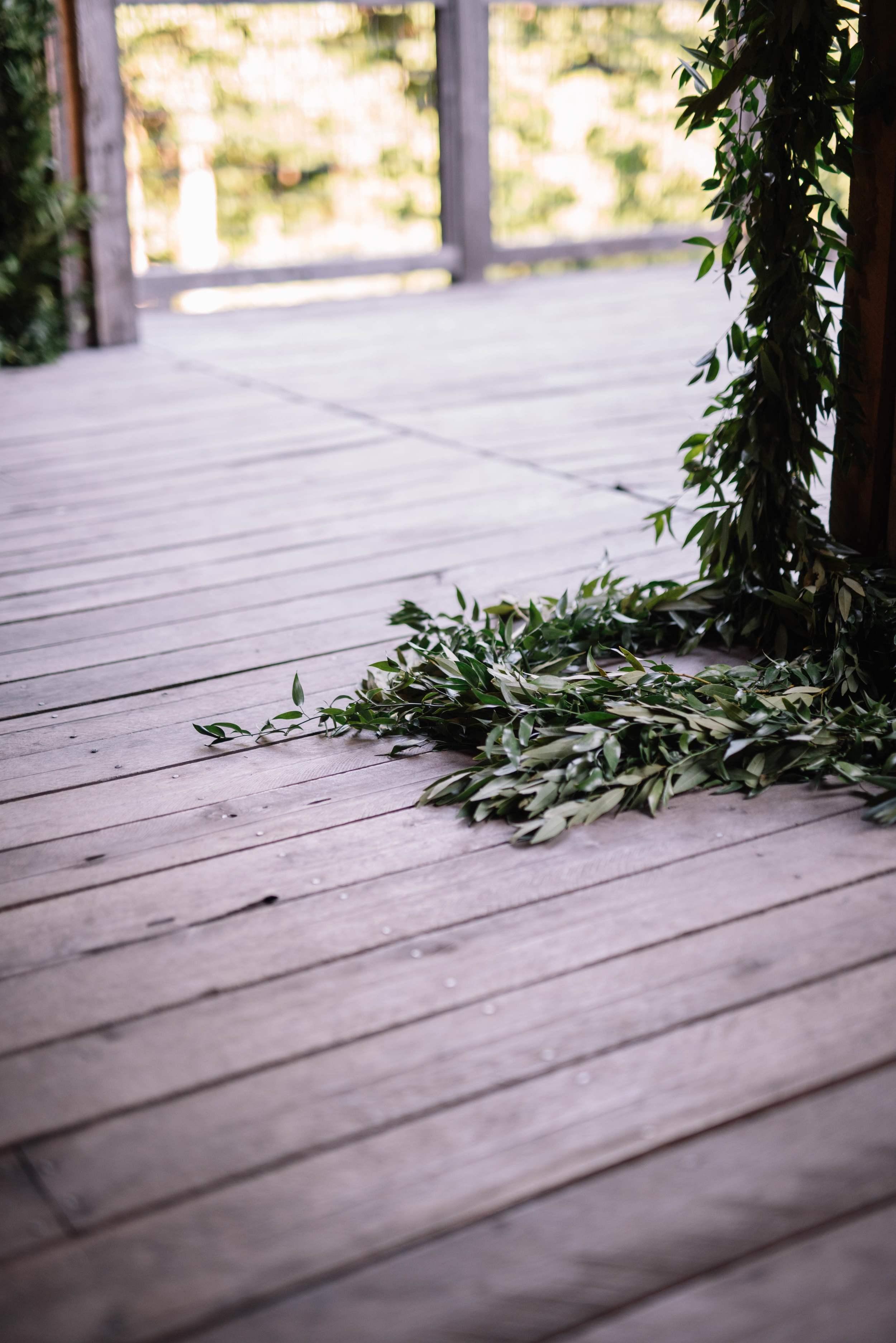 Lush greenery garland ceremony backdrop // Nashville Floral Design