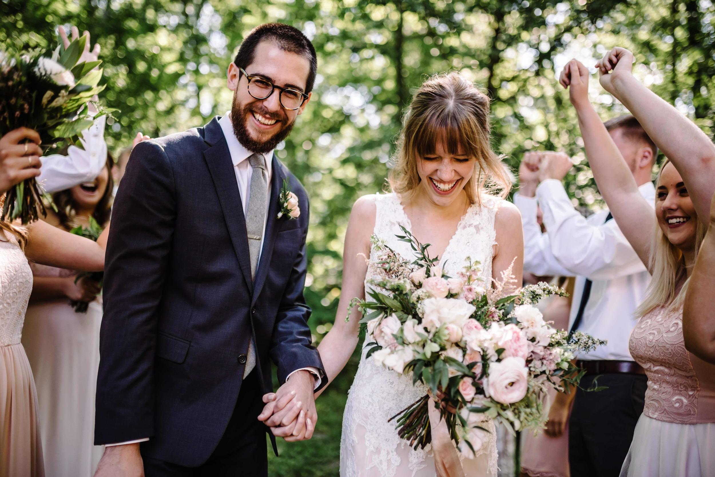 Joyful bride and groom // Nashville Florist