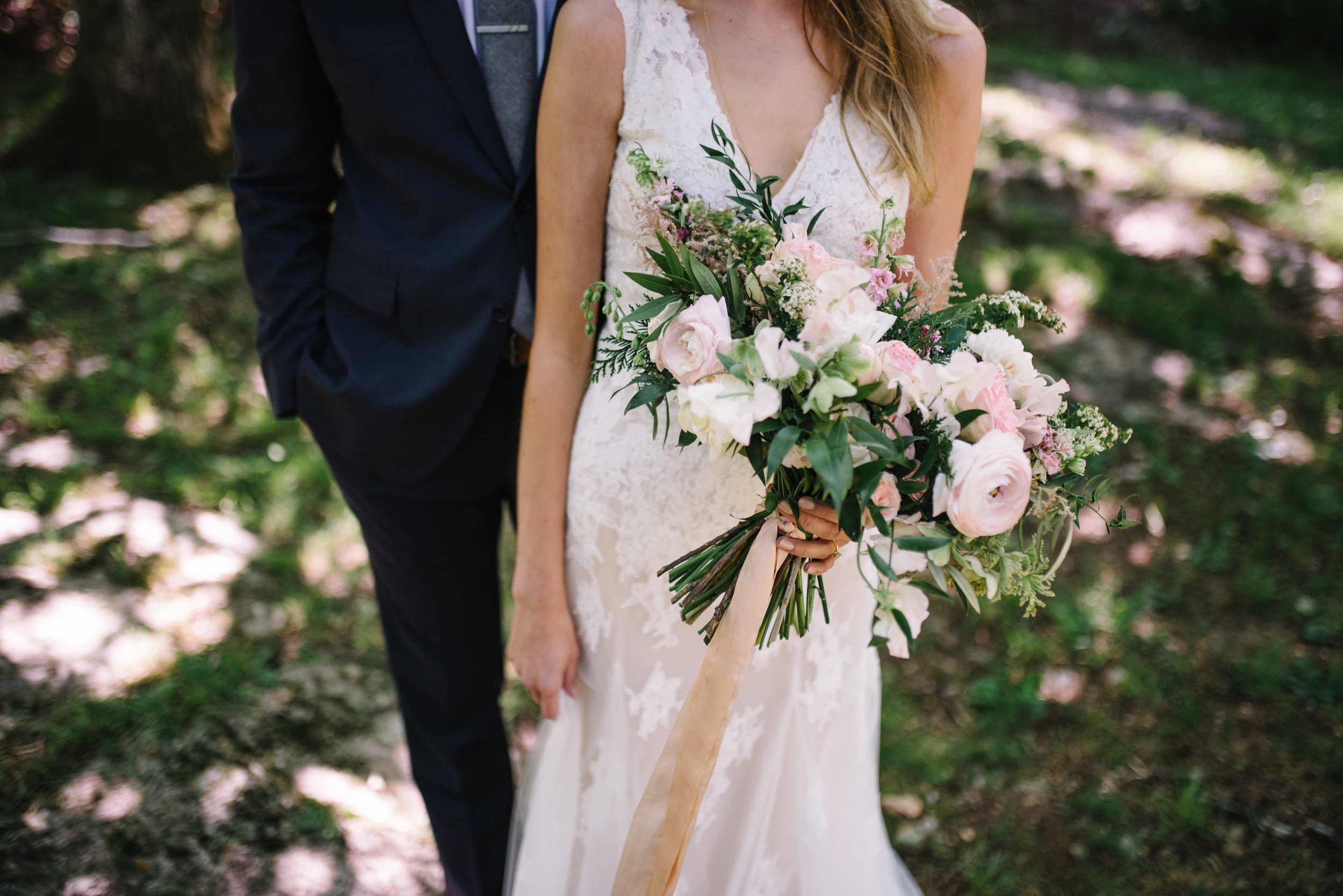 Lush bridal bouquet with pale pink ranunculus and spirea // Springtime Wedding Florals