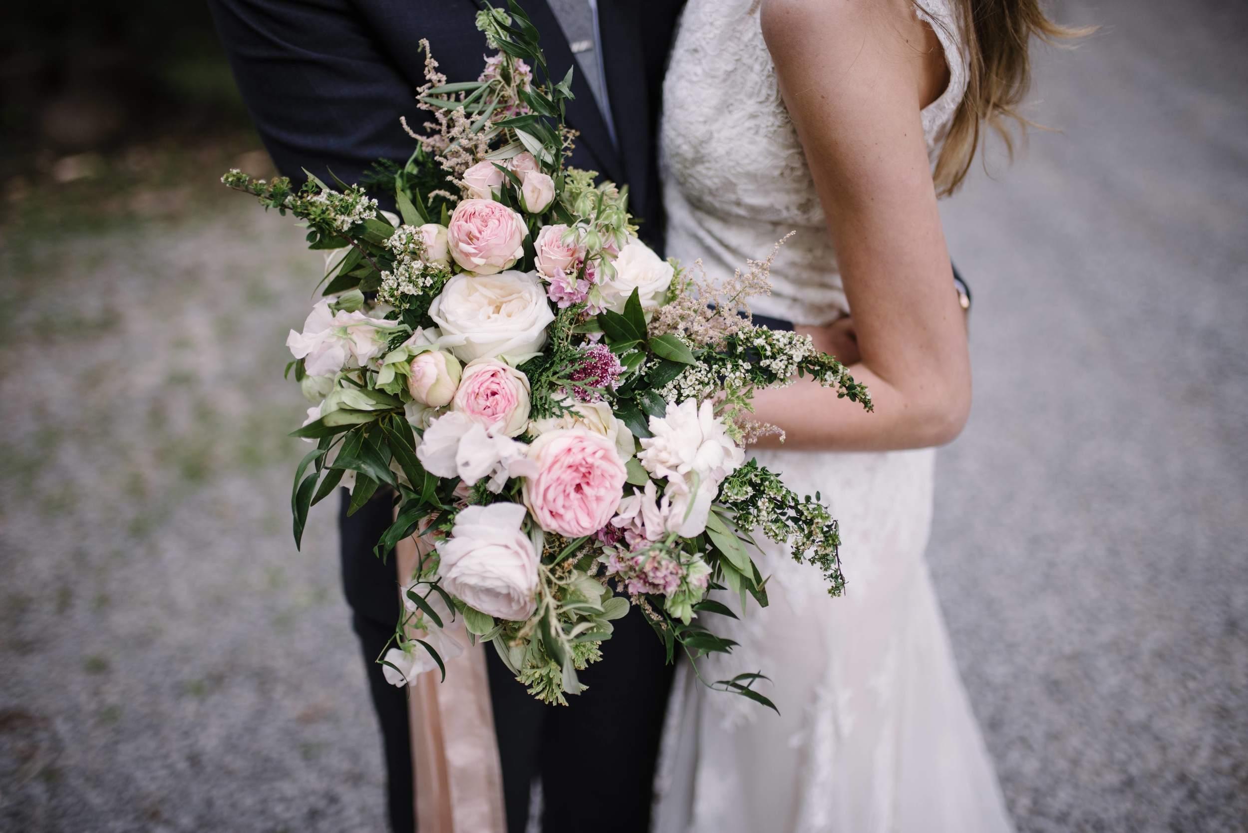 Lush bridal bouquet with garden roses, ranunculus, and sweet peas // Nashville Wedding Florist