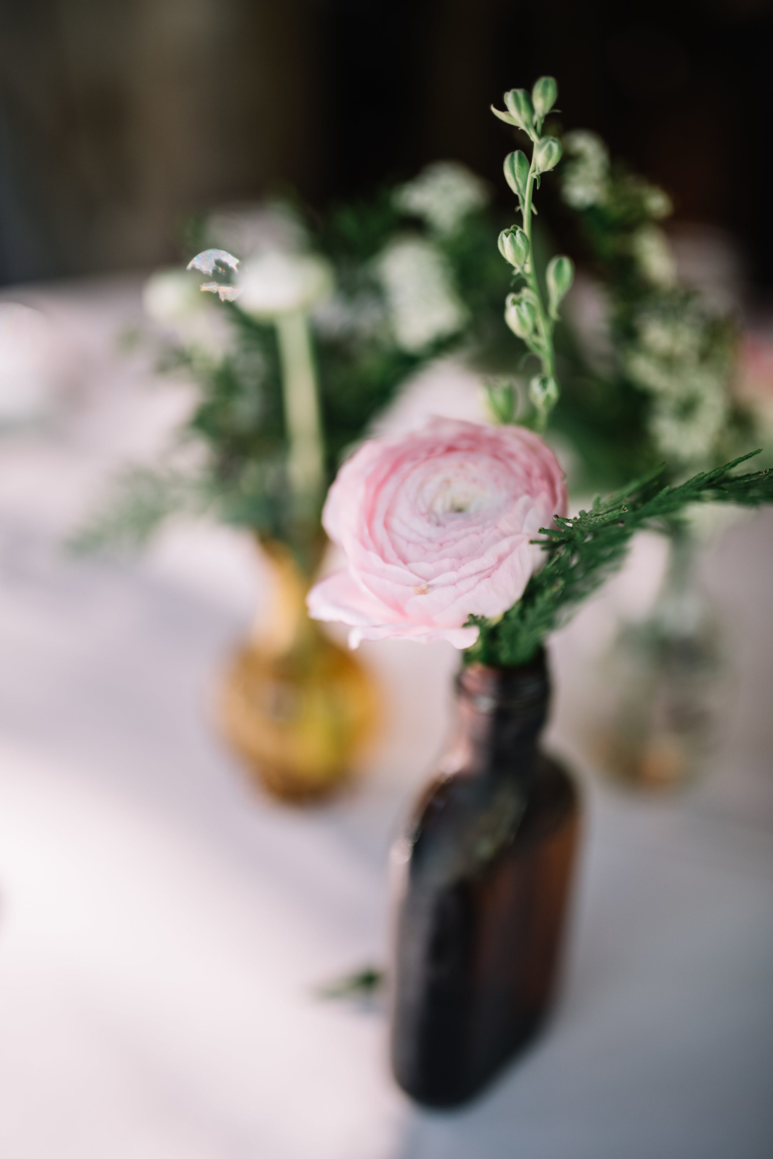 Amber bud vases with blush and white and greenery florals // Nashville Wedding Flowers