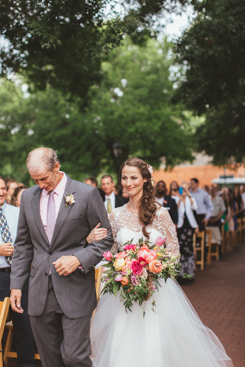 Walking down the aisle // bright, lush floral design in Dallas