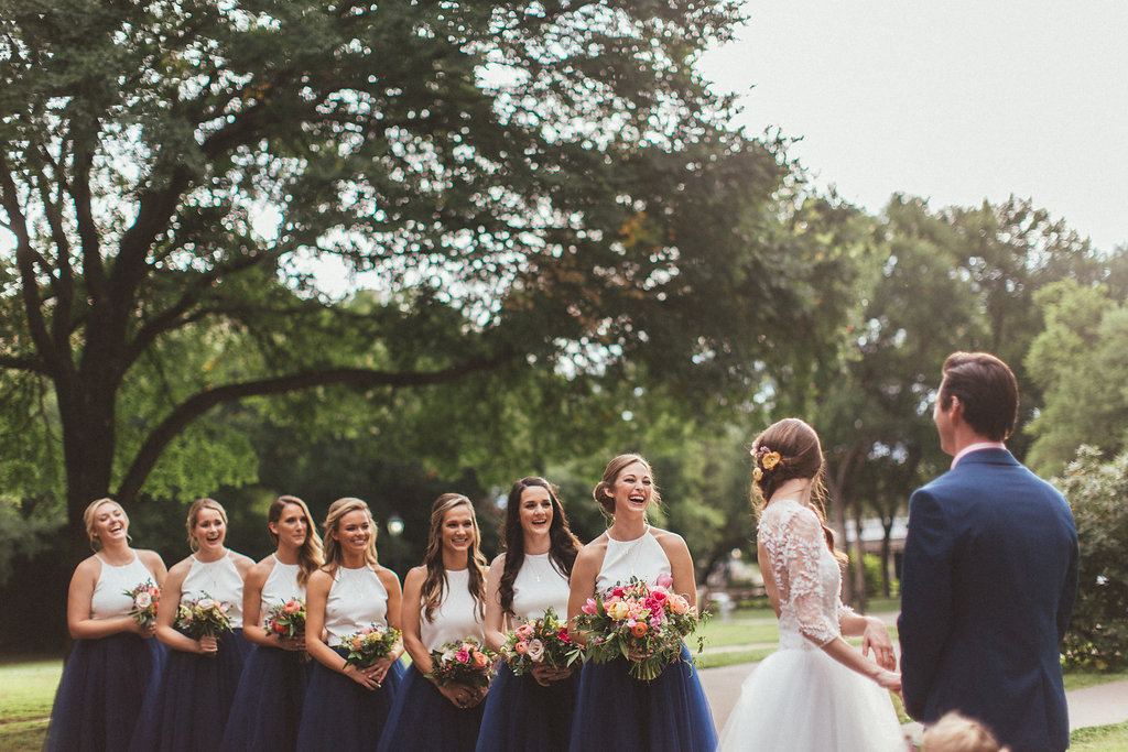 Navy tulle skirts for the bridesmaids, pink and coral florals // Dallas Wedding Floral Design