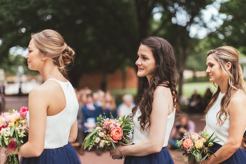 White crop top and navy tulle skirts for bridesmaids // Lush, organic floral design in Nashville, TN