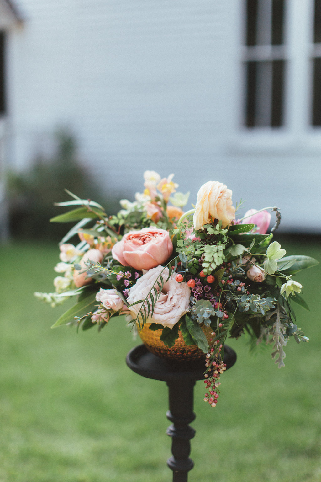 Peach ranunculus, garden roses, and loose greenery // Dallas Wedding Florals