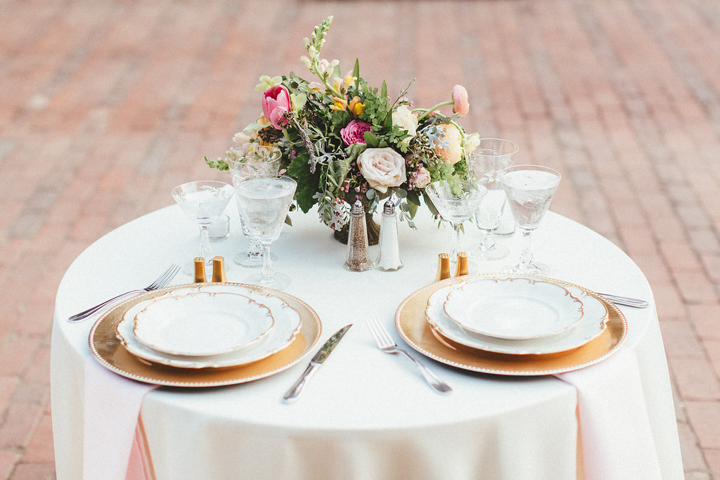 Sweetheart table with gold plates and bright flowers / Dallas Heritage Village Wedding