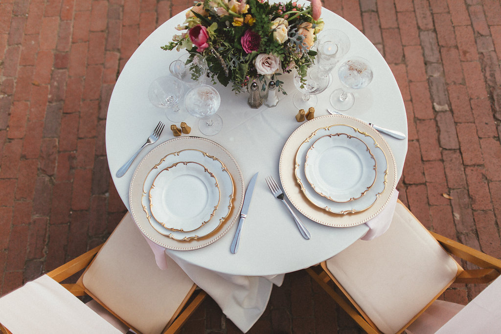 Sweetheart table with gold chargers and cheery, bright florals // Natural Wedding Floral Design