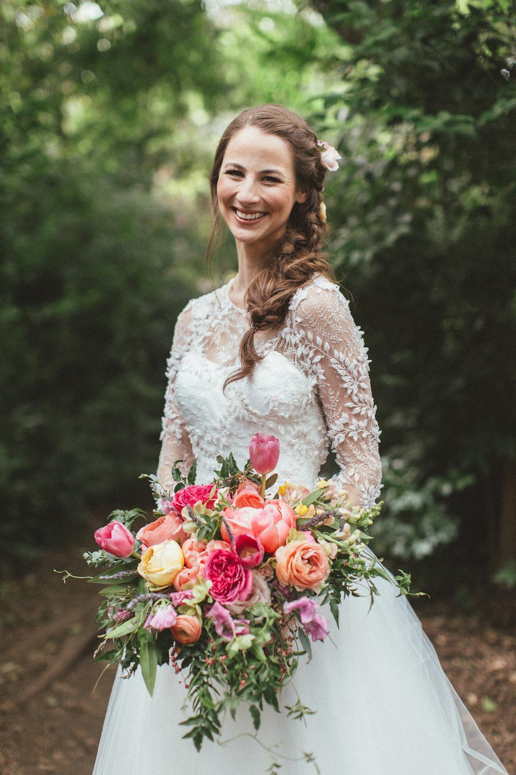 Coral charm peonies, peach ranunculus, cascading bridal bouquet // Dallas Floral Design