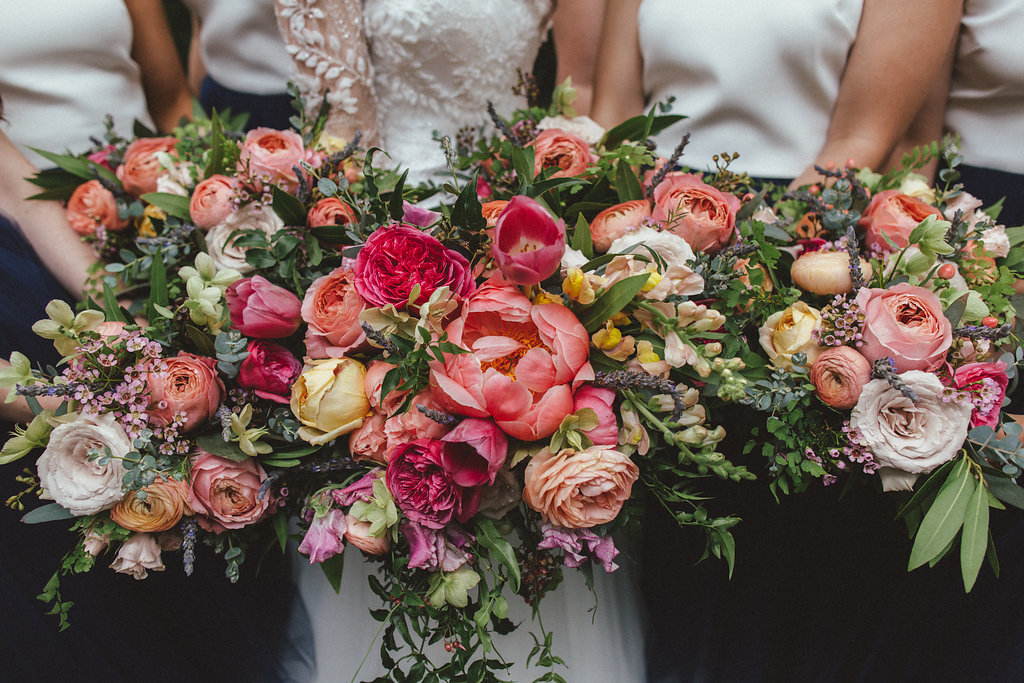 Coral, pinks, and peach florals with lush, trailing greenery // Nashville Floral Design for Weddings