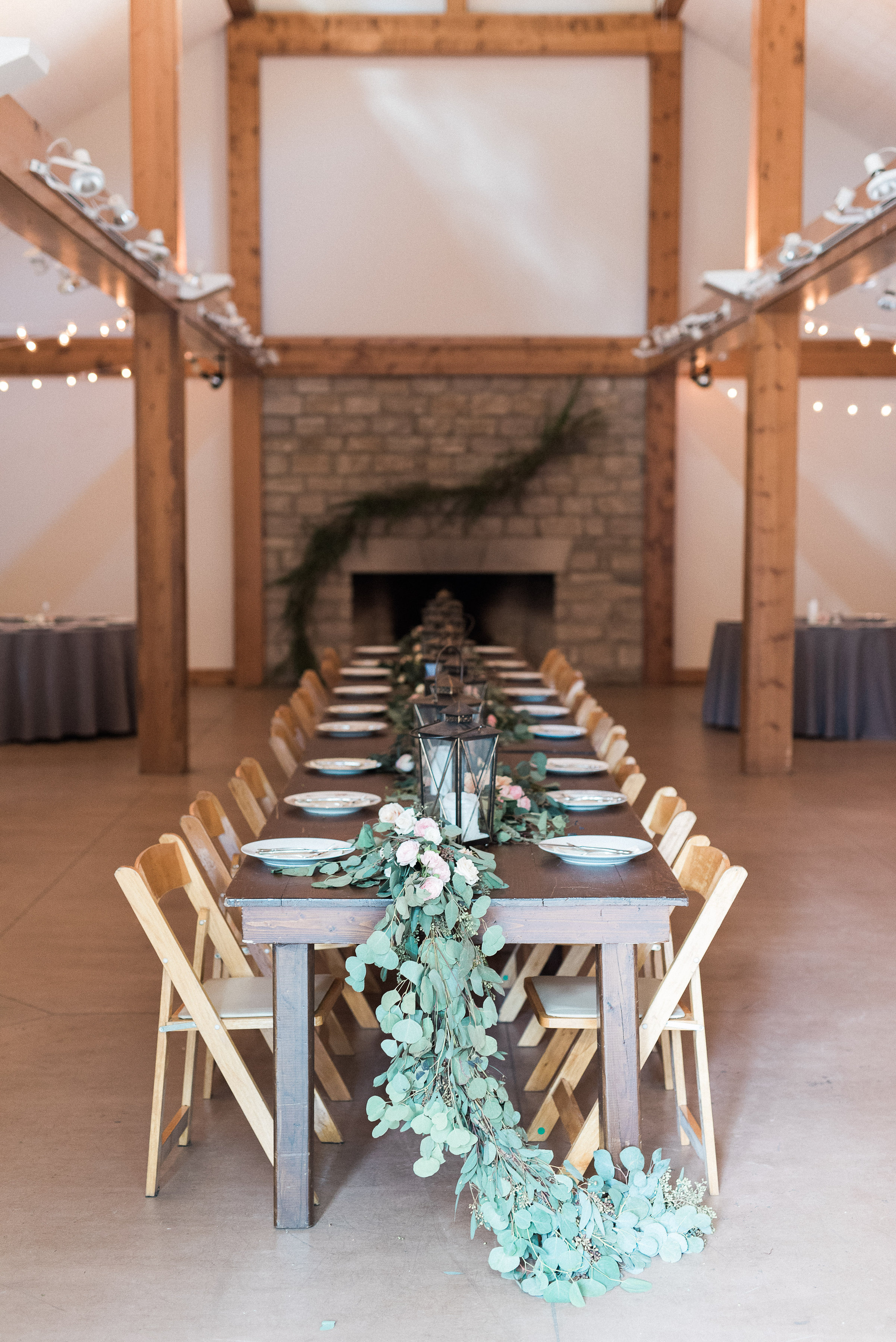 Eucalyptus Garland trailing off the ends of the head table // Nashville Wedding Florist