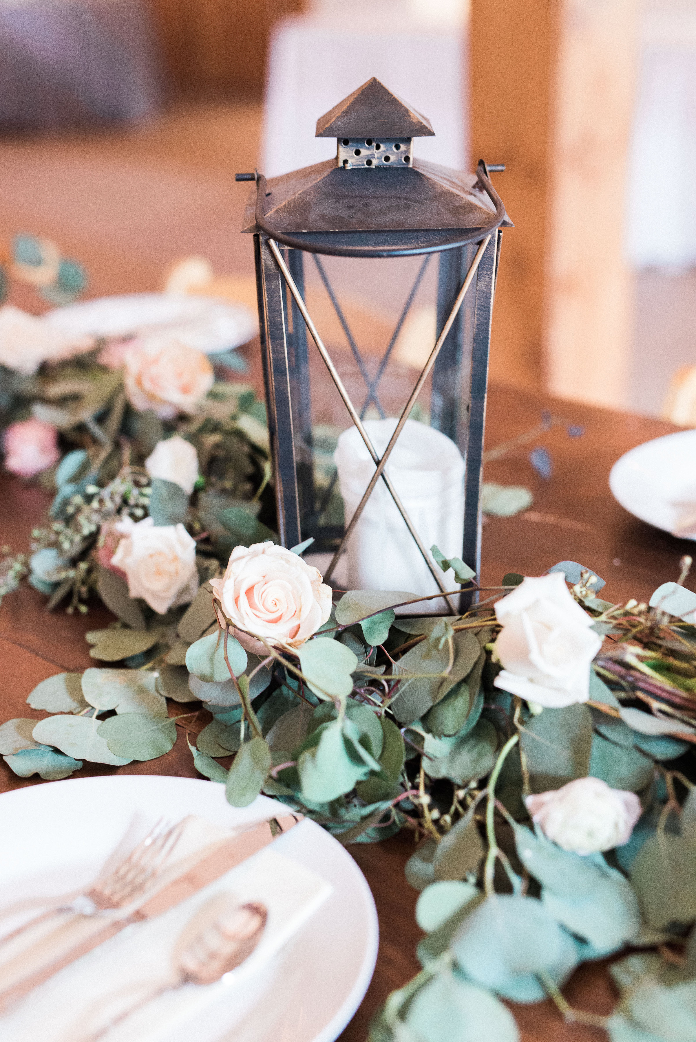 Lanterns with floral and eucalyptus garland for head table // Nashville Wedding Floral Design