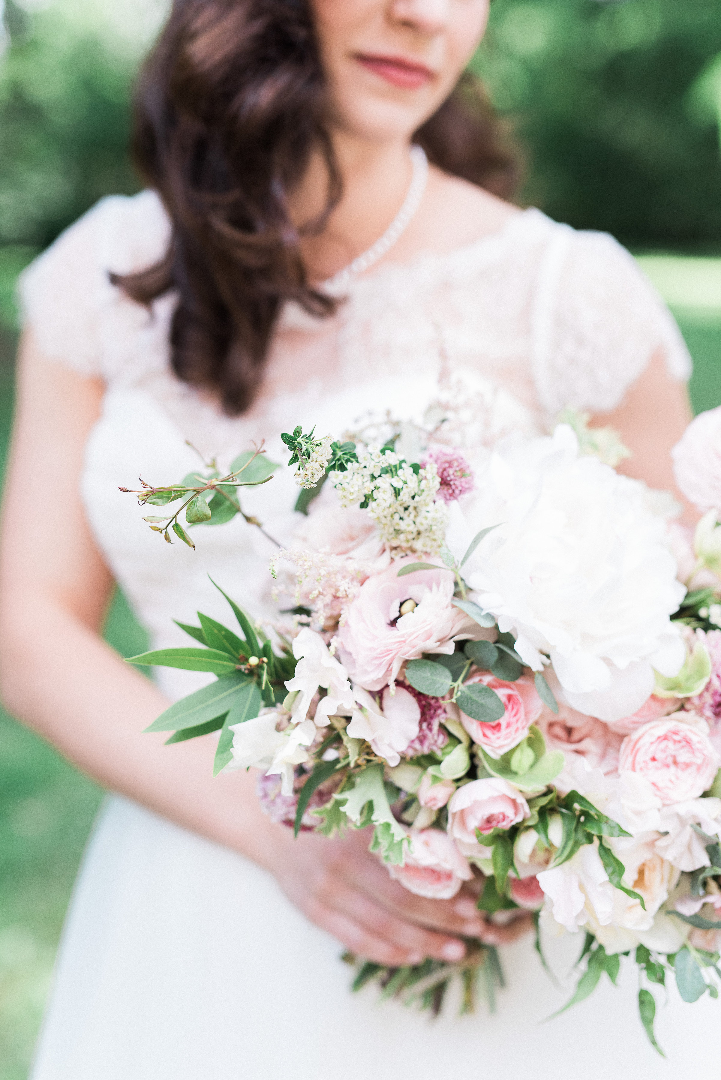 Blush and ivory bridal bouquet with peonies and ranunculus // Nashville Wedding Florist