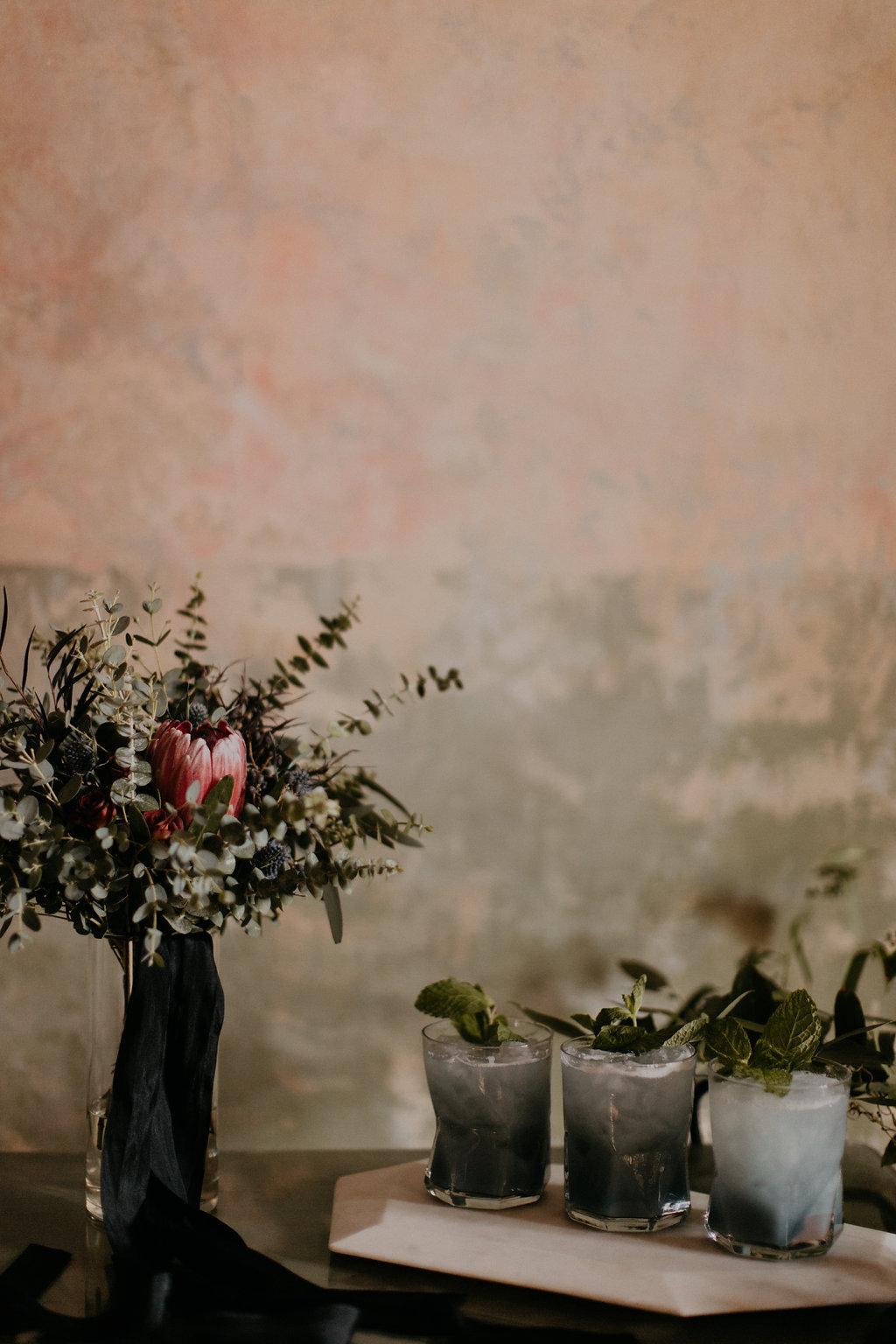 Marble candle holders, lush, wintry florals, fancy cocktails // Nashville Wedding Florist