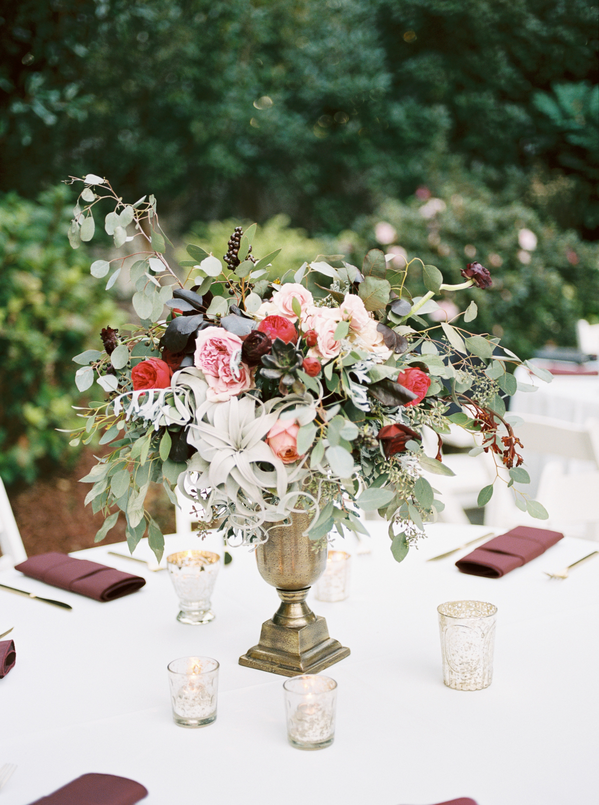 Deep red, marsala, burgundy florals with garden roses, air plants, and ranunculus // Nashville Wedding Florist