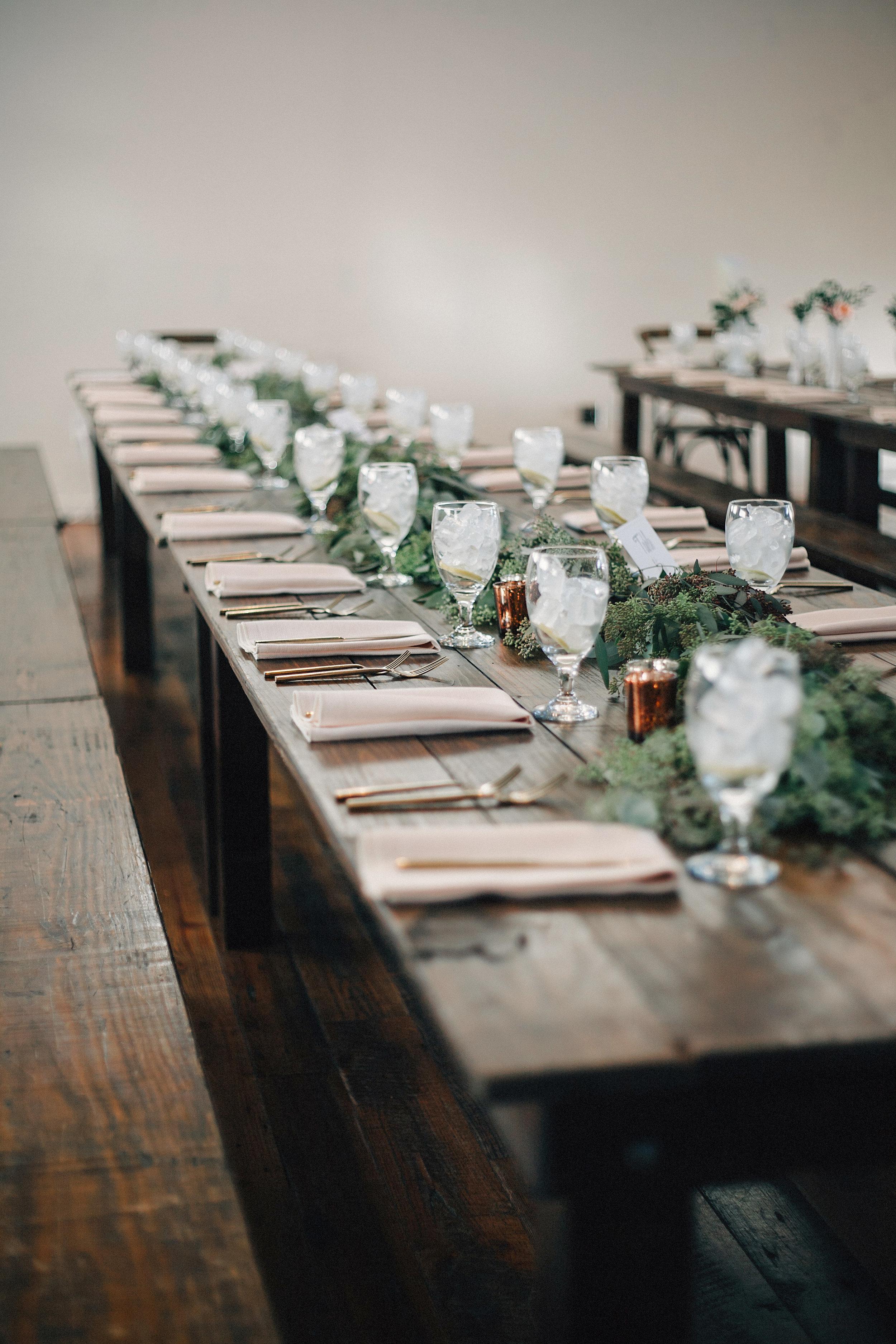 Eucalyptus garland on farm tables at the Cordelle // Nashville Wedding Florist