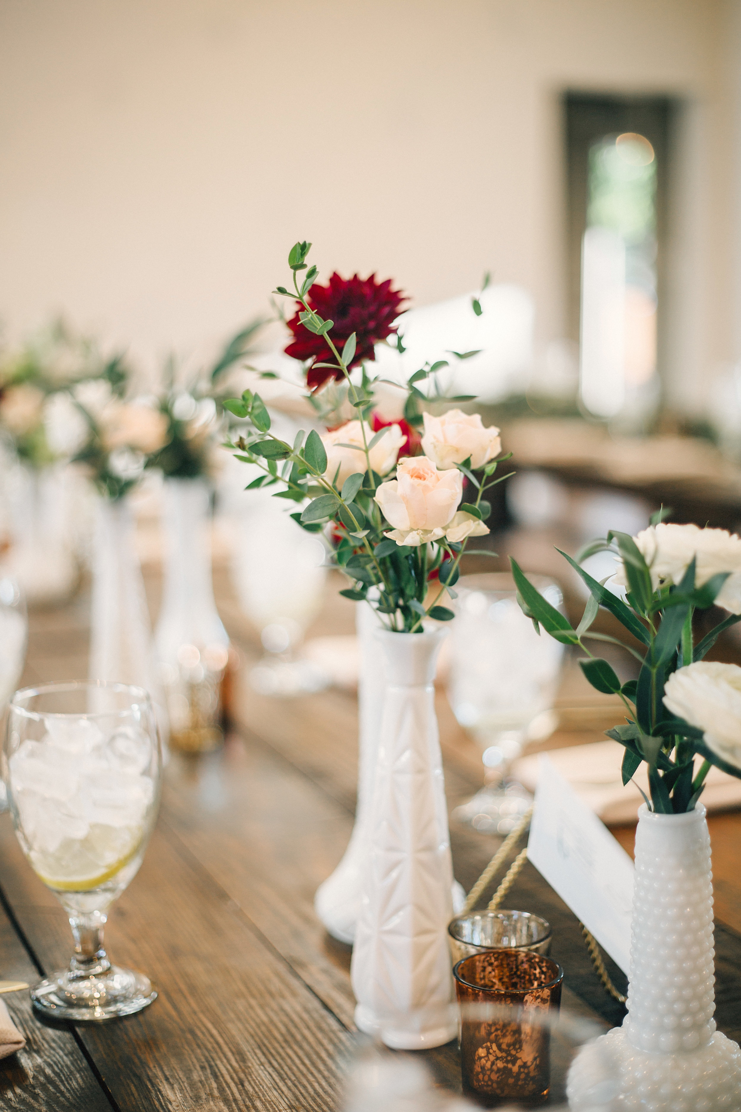 Milk glass bud vases on wooden farm tables // Natural Floral Design in Nashville, TN