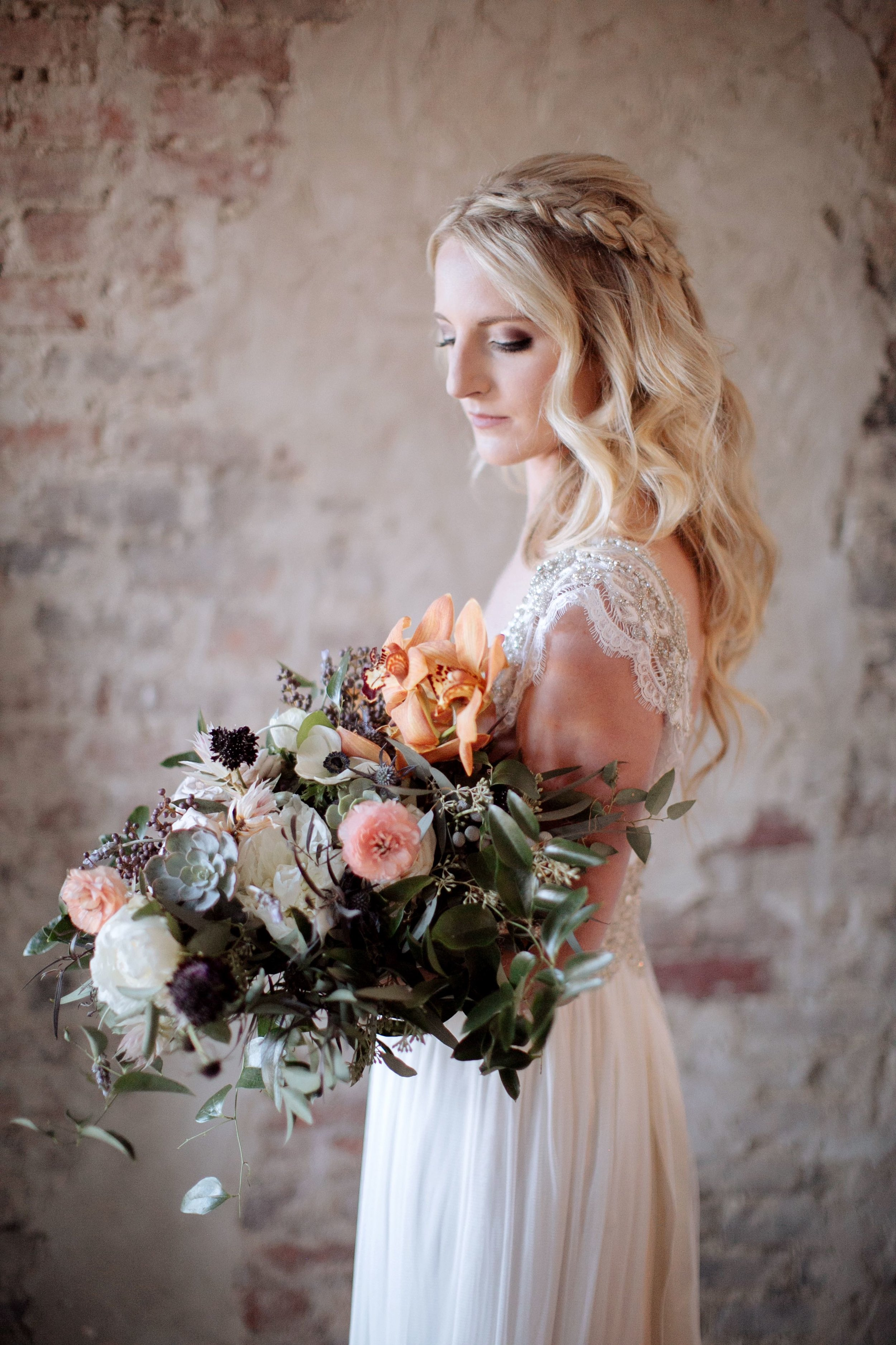 Whimsical, organic bridal bouquet with neutral, blush, and copper tones, using orchids, ranunculus, and garden roses // Nashville Wedding Florist