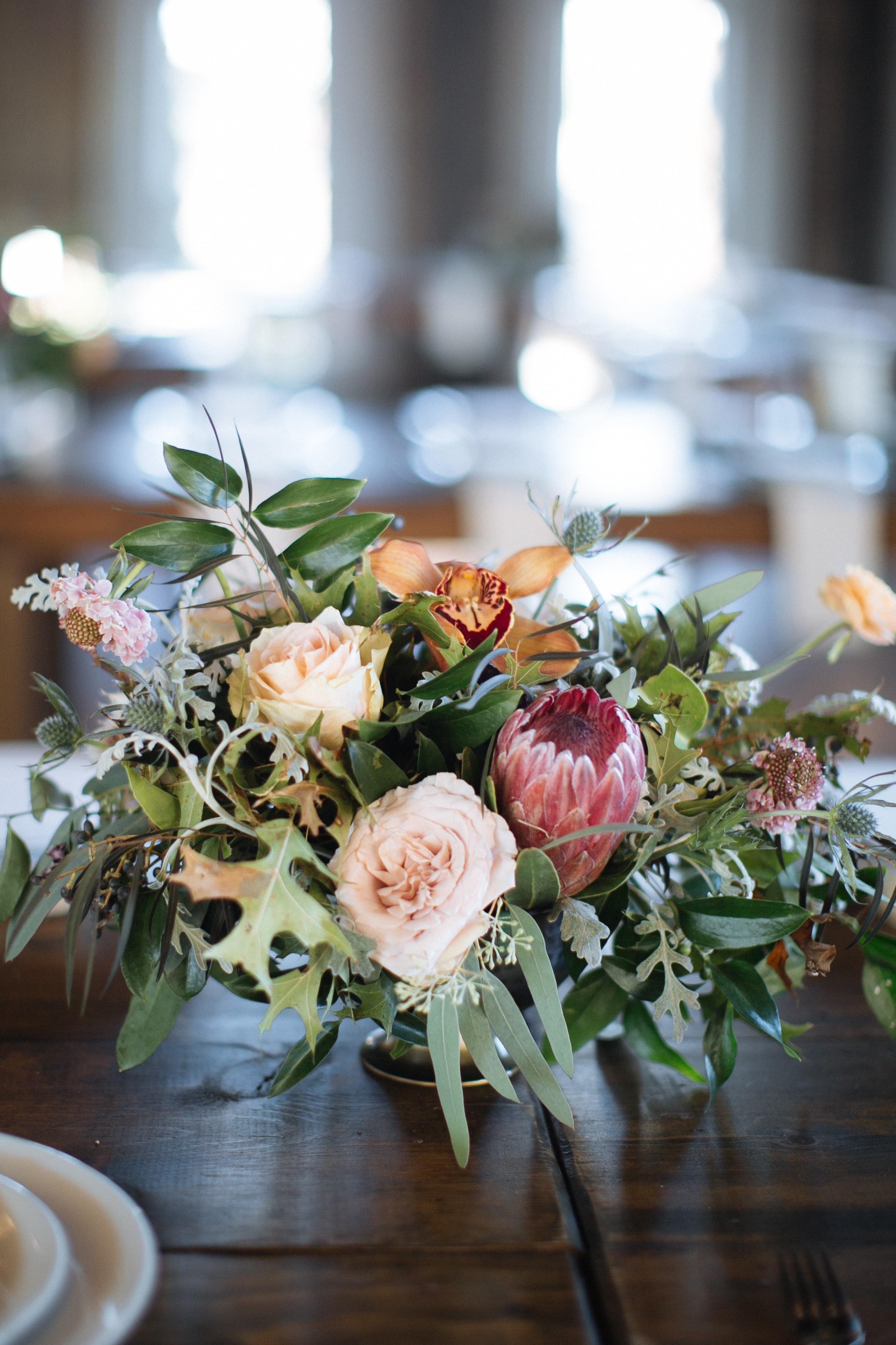 Natural floral centerpiece with garden roses and ranunculus // Nashville Wedding Floral Design