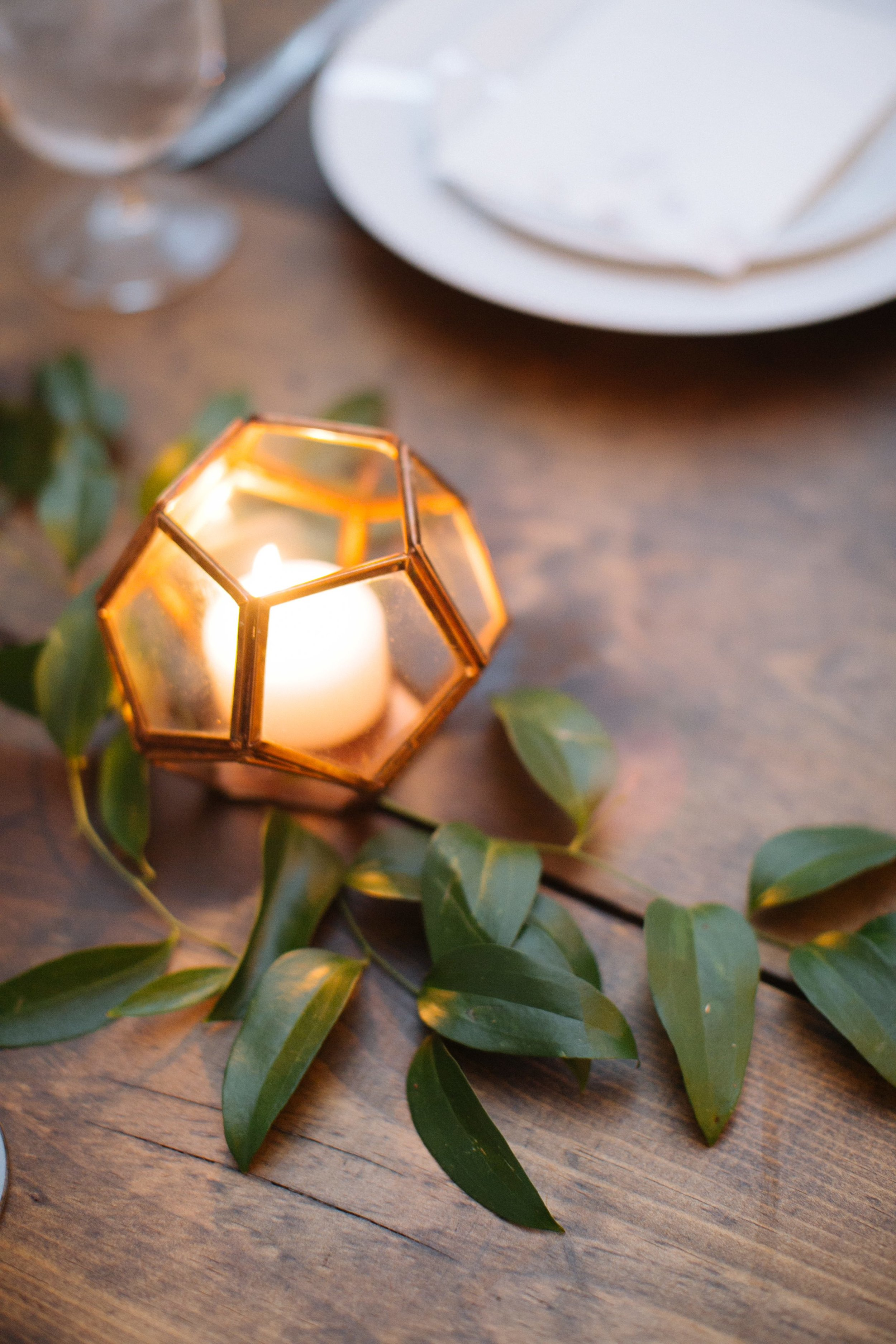 Geometric copper lantern with natural greenery accents // Nashville Wedding Floral Design