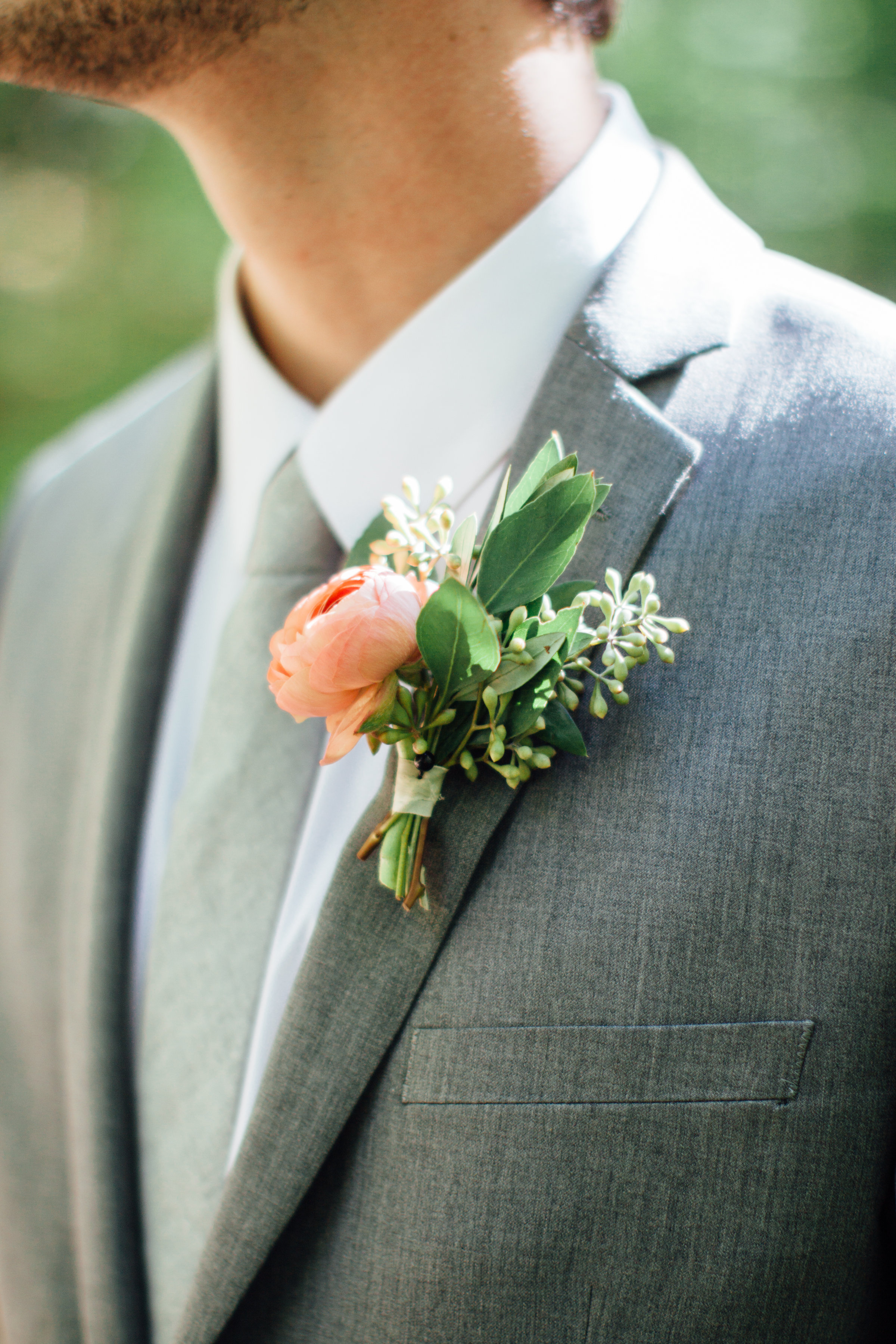 Peach ranunculus boutonniere // Southern Wedding Florist
