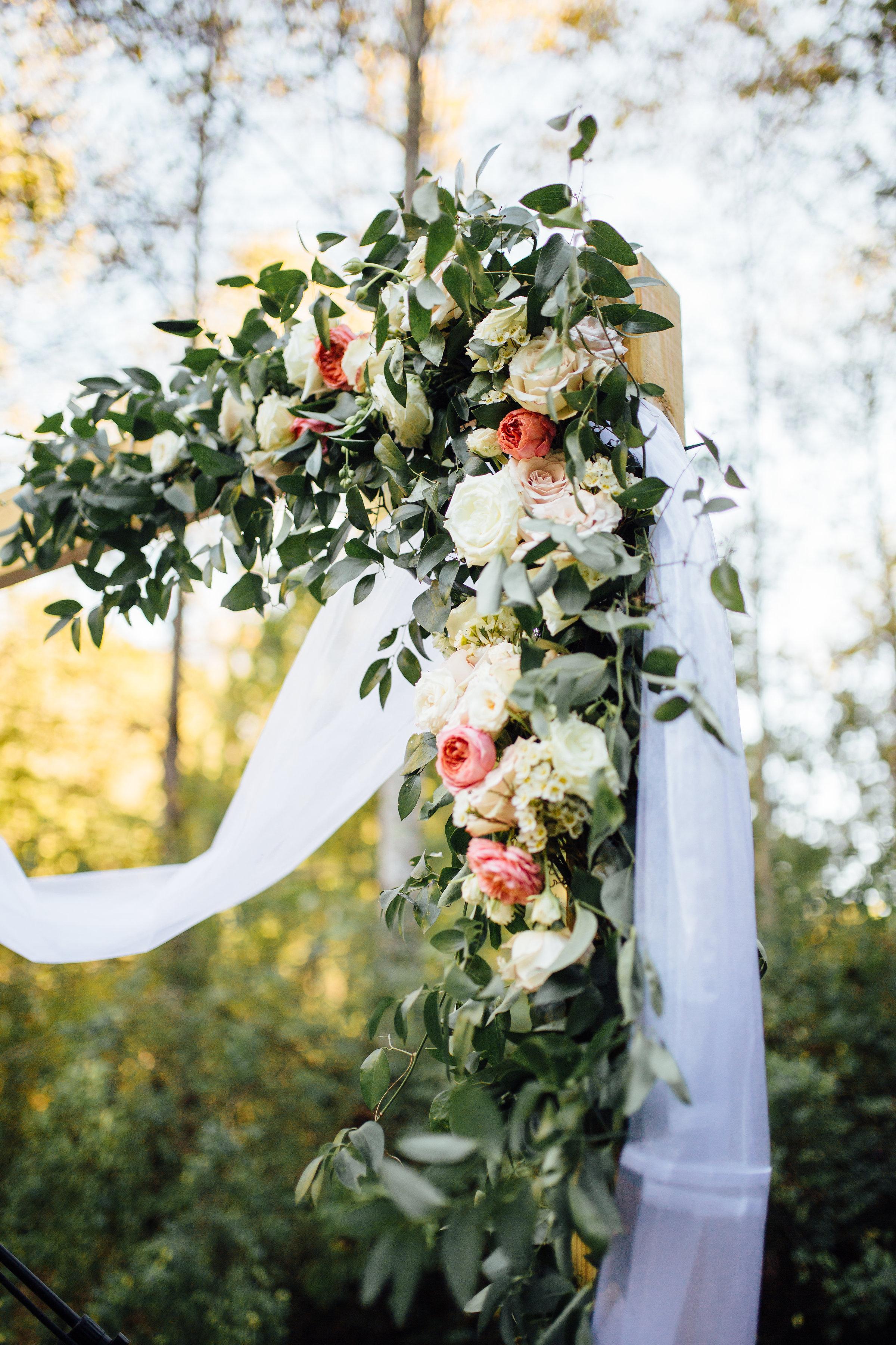 Natural, organic wedding ceremony backdrop with garden roses and ranunculus // Nashville Wedding Florist