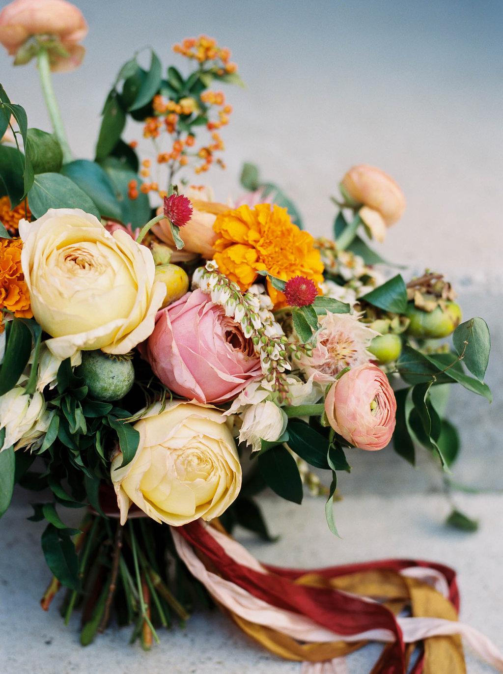 Bright, summery bridal bouquet with rosy pink garden roses and orange marigolds // Nashville Wedding Florist